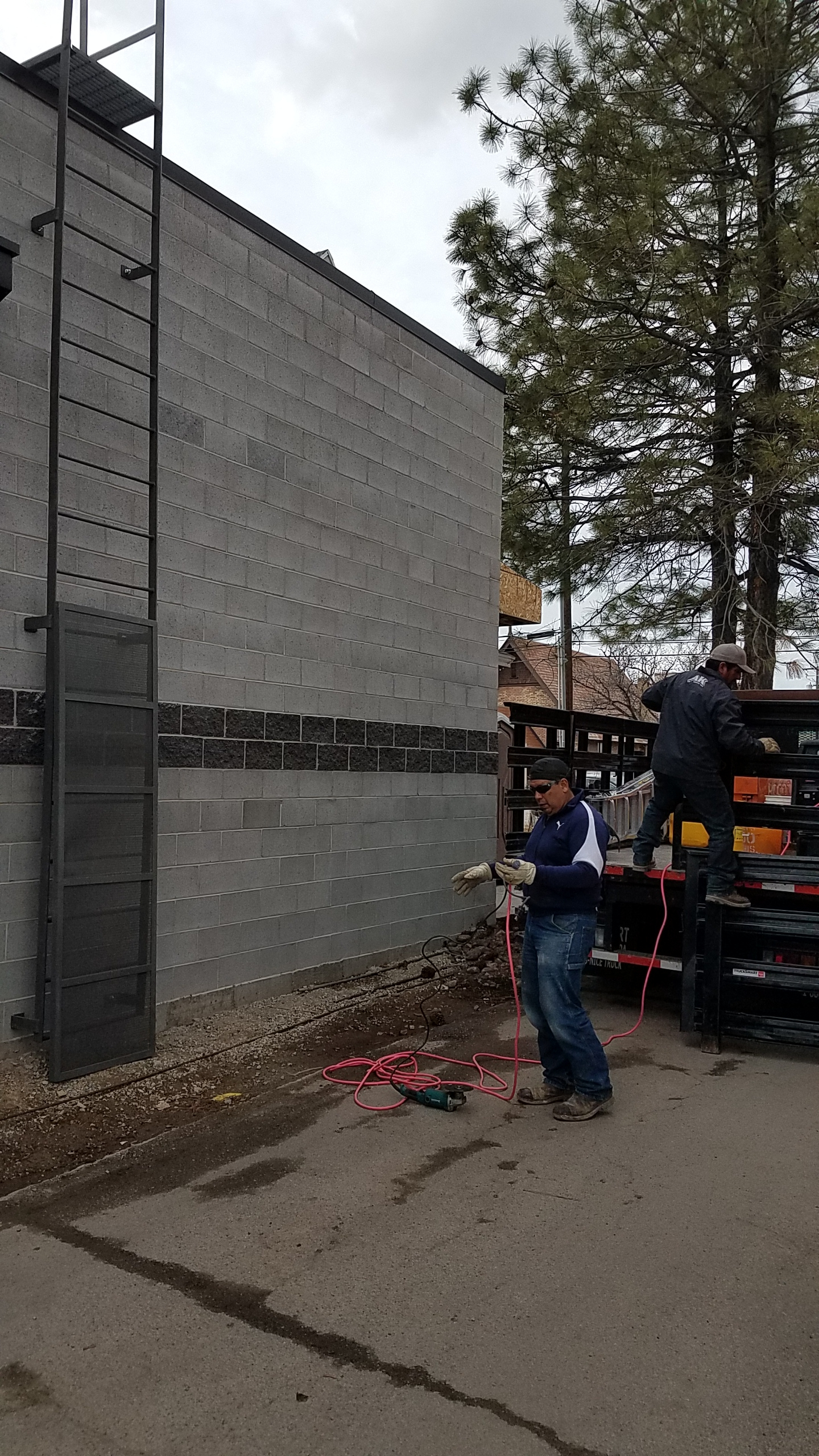 The exterior ladders showed up making it a lot easier to get on the roof when needed.