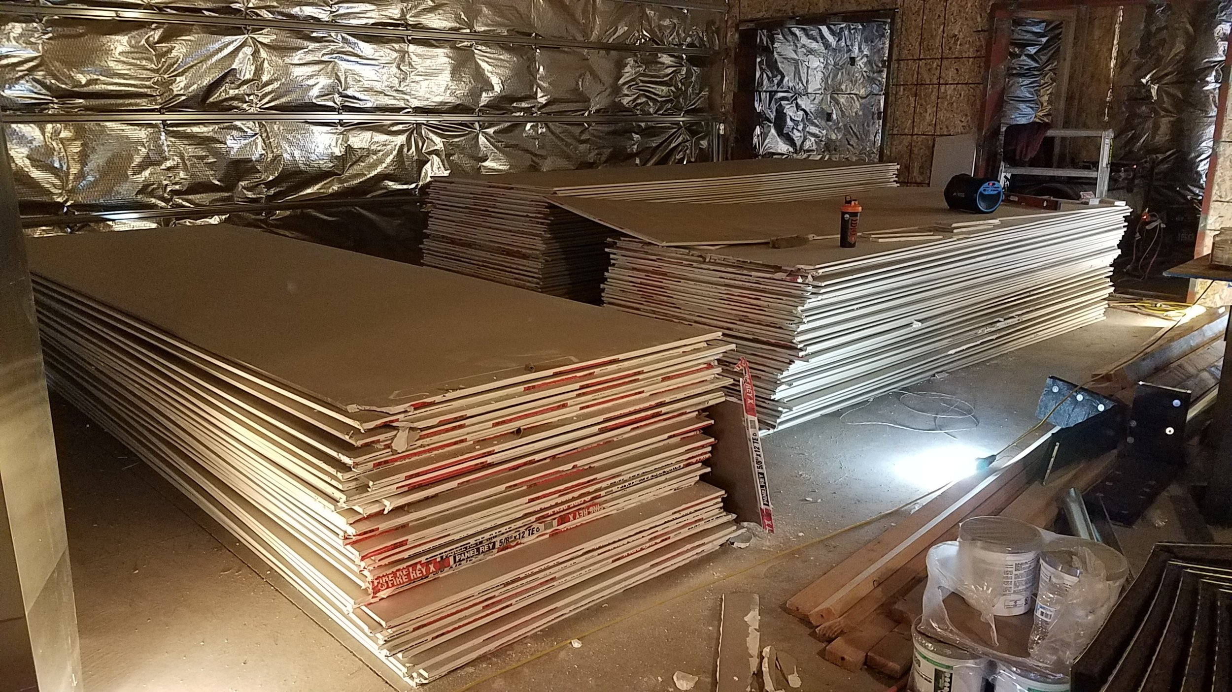 Sheet rock showed up, a LOT of sheet rock. We have piles like this in most rooms of the studio and we don't even have it all yet.