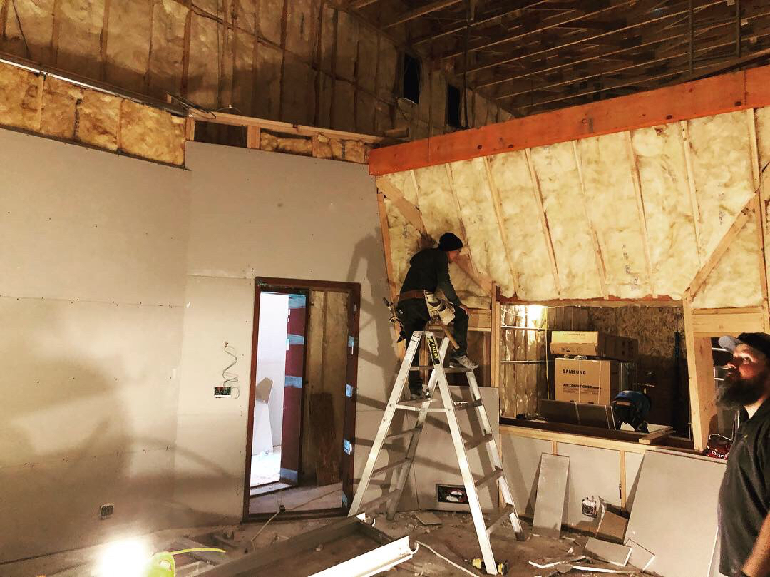 First layer of sheet rock goes up in control room 2.