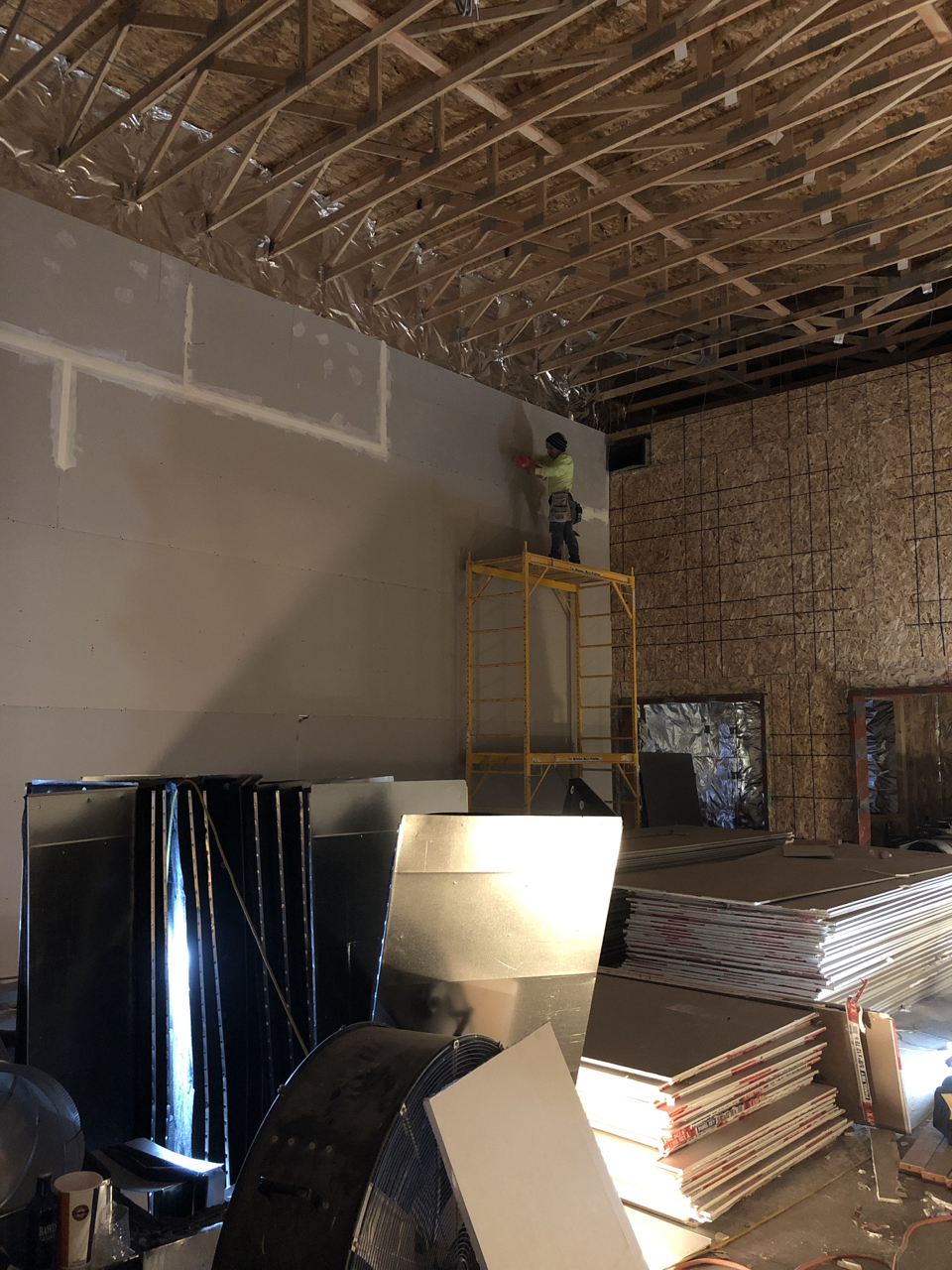 First layer going up in studio 1. You can see the hvac duct coming through the top of the wall above the iso booth door. The ceiling will hang just above that duct.