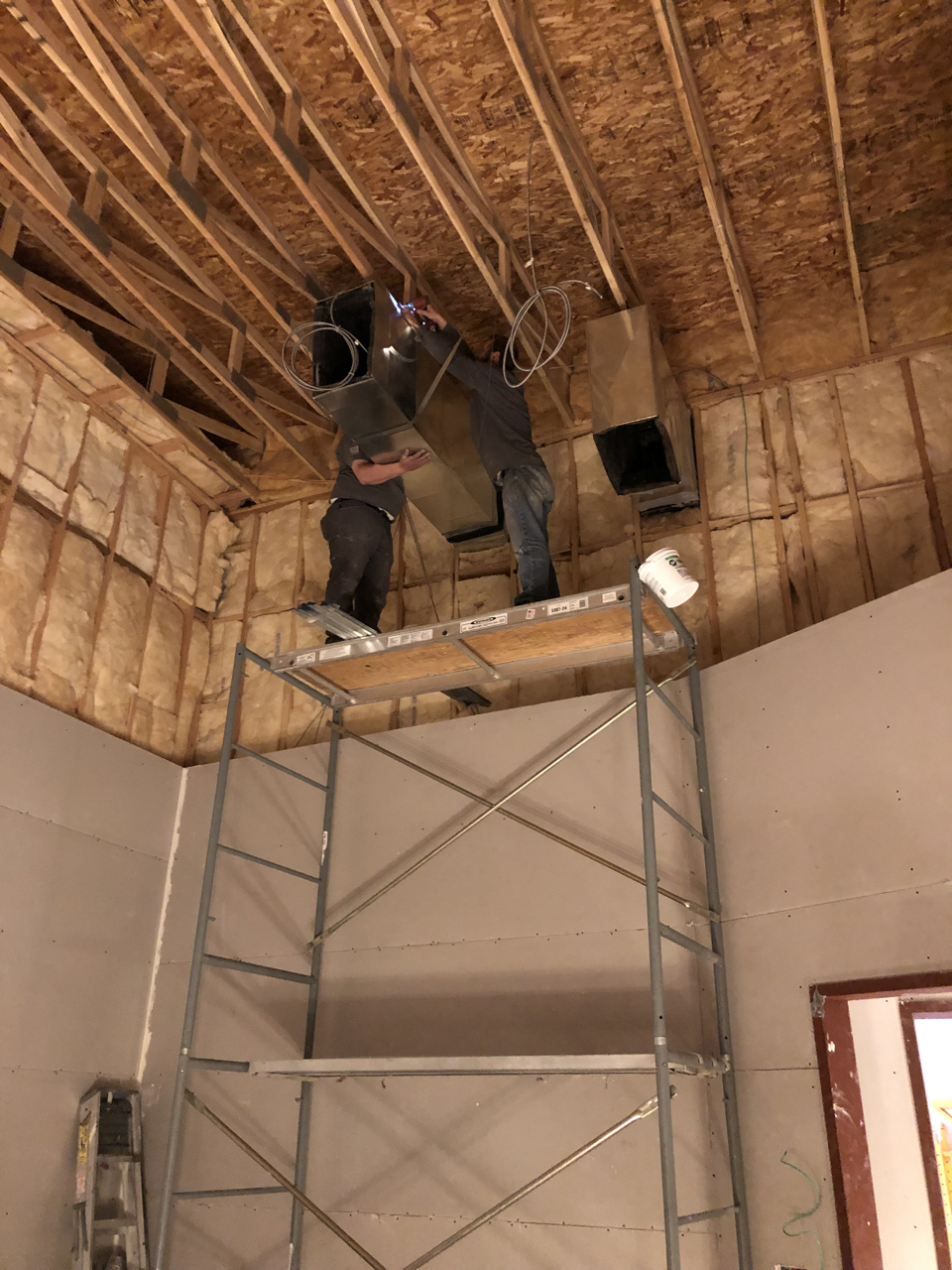 HVAC duct coming into the space above control room 2. It's a very tricky space to maneuver the ductwork through as they need to stay clear of the wire hanging from the trusses that will hold the ceiling structure.