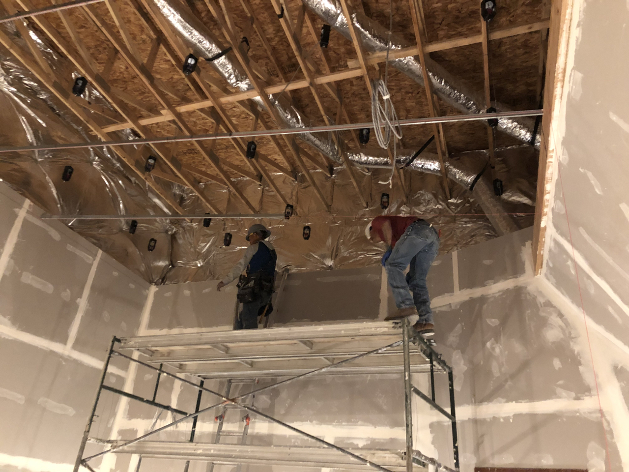 The crew started by hanging tracking room 1 as it was a rectangle and level, now they are moving on to control room 1 which is a sloped ceiling and not quite so full of right angles.