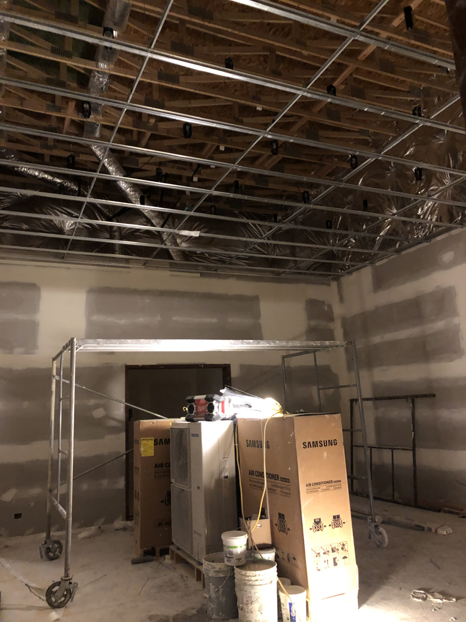 Tracking room 2 with the ceiling grid hung and ready for sheetrock.