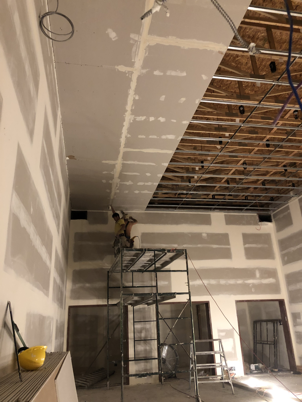 First of three layers of sheetrock going up in tracking room 1.