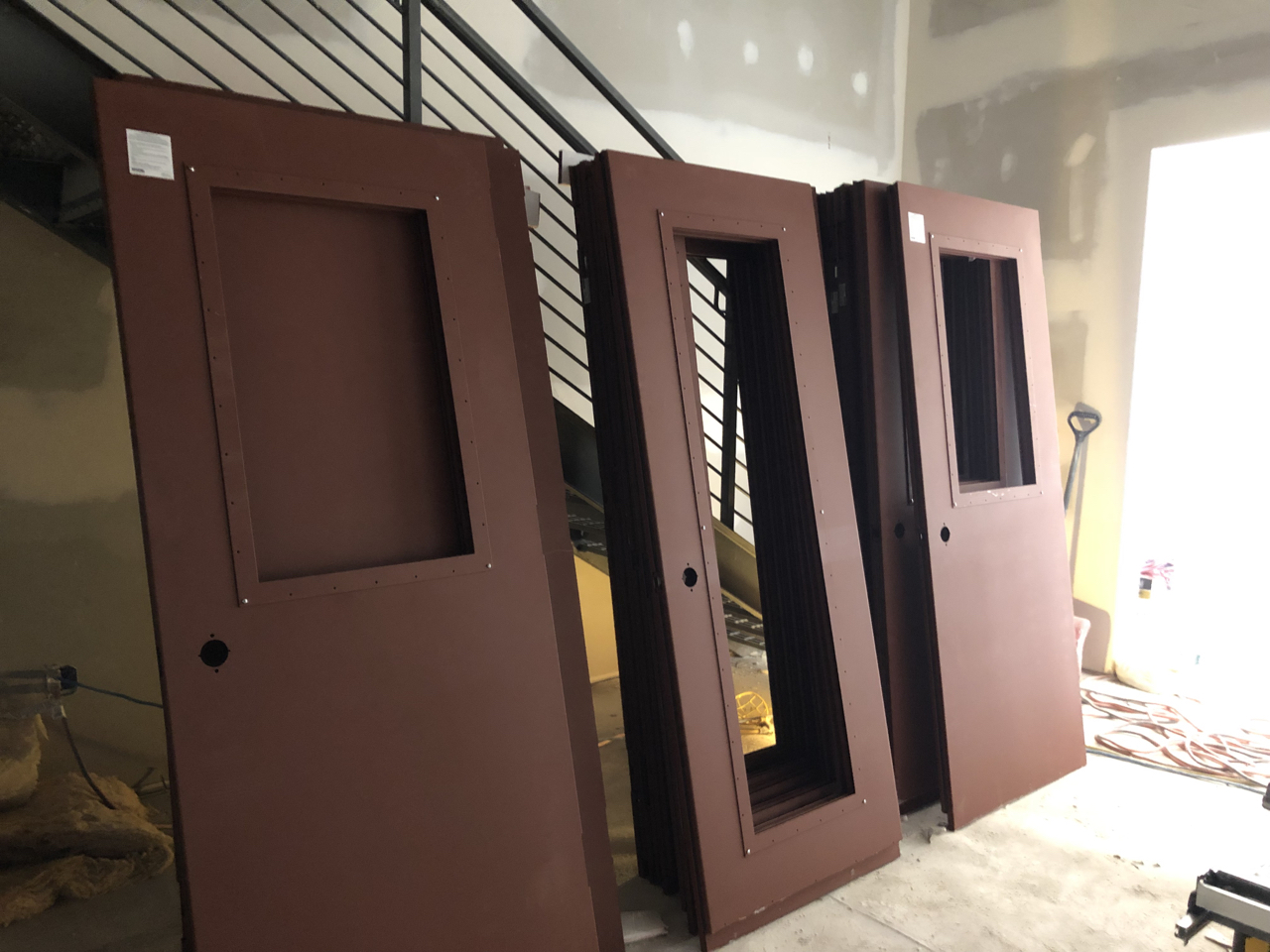 On Thursday the    Overly acoustic doors    arrived. The doors are so heavy that the installers - three big guys, have a hard time lifting them and getting them on the hinges. The solid slabs are 51db doors and the doors with windows are 47db.