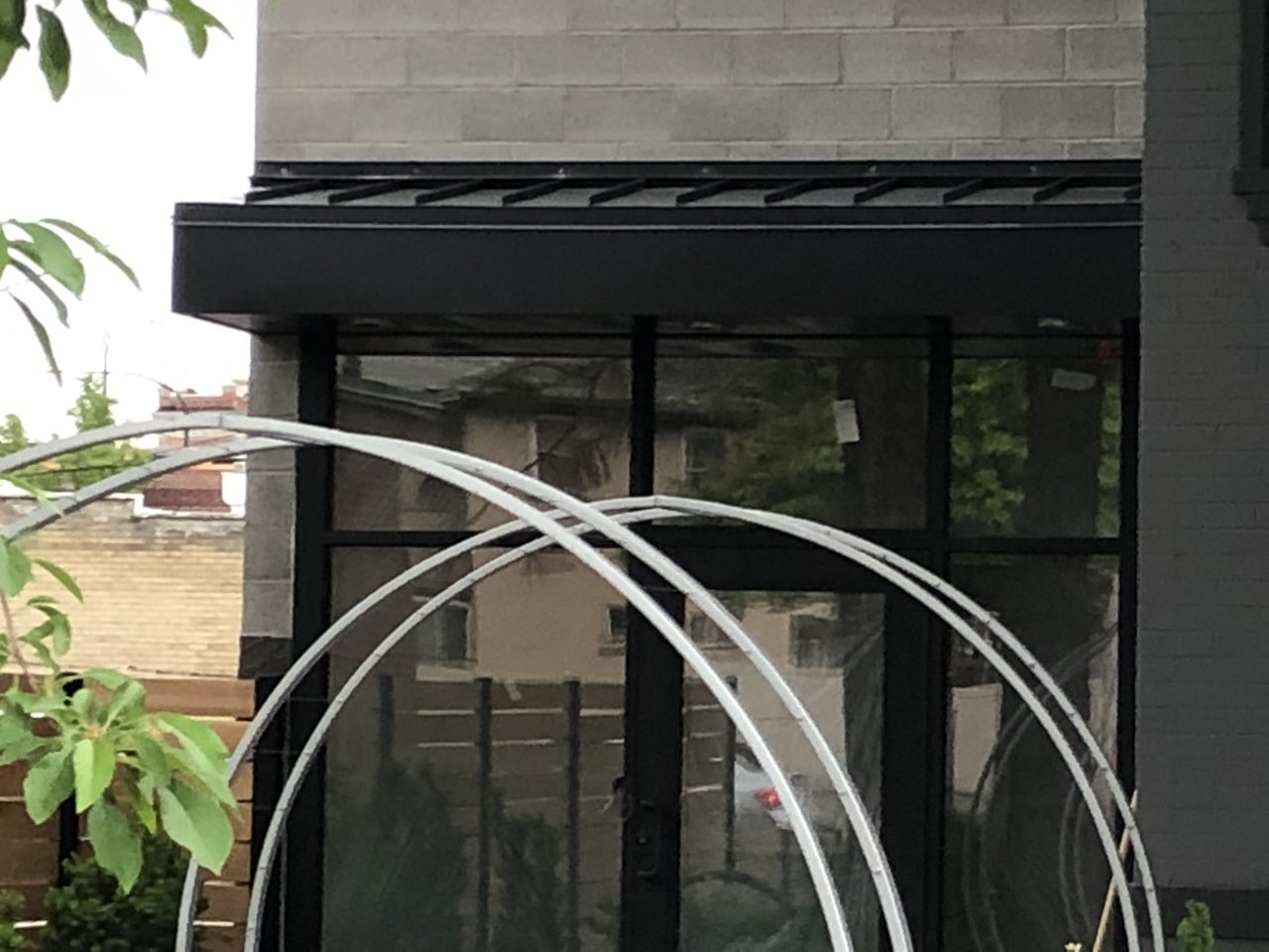 The metal work on the three outer door canopies was completed.
