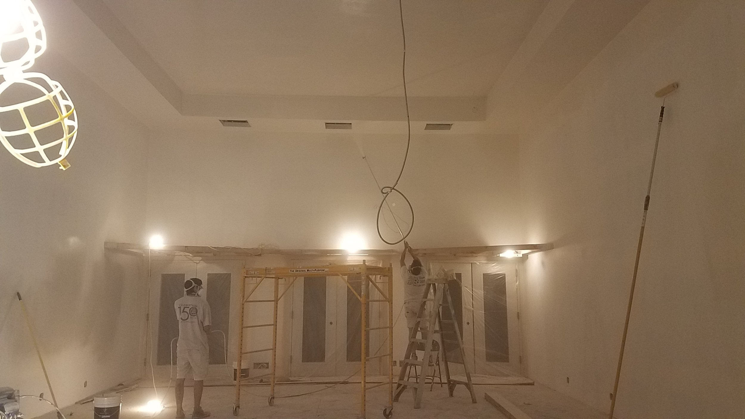 Doors are taped up and now painting the walls and ceiling begins.