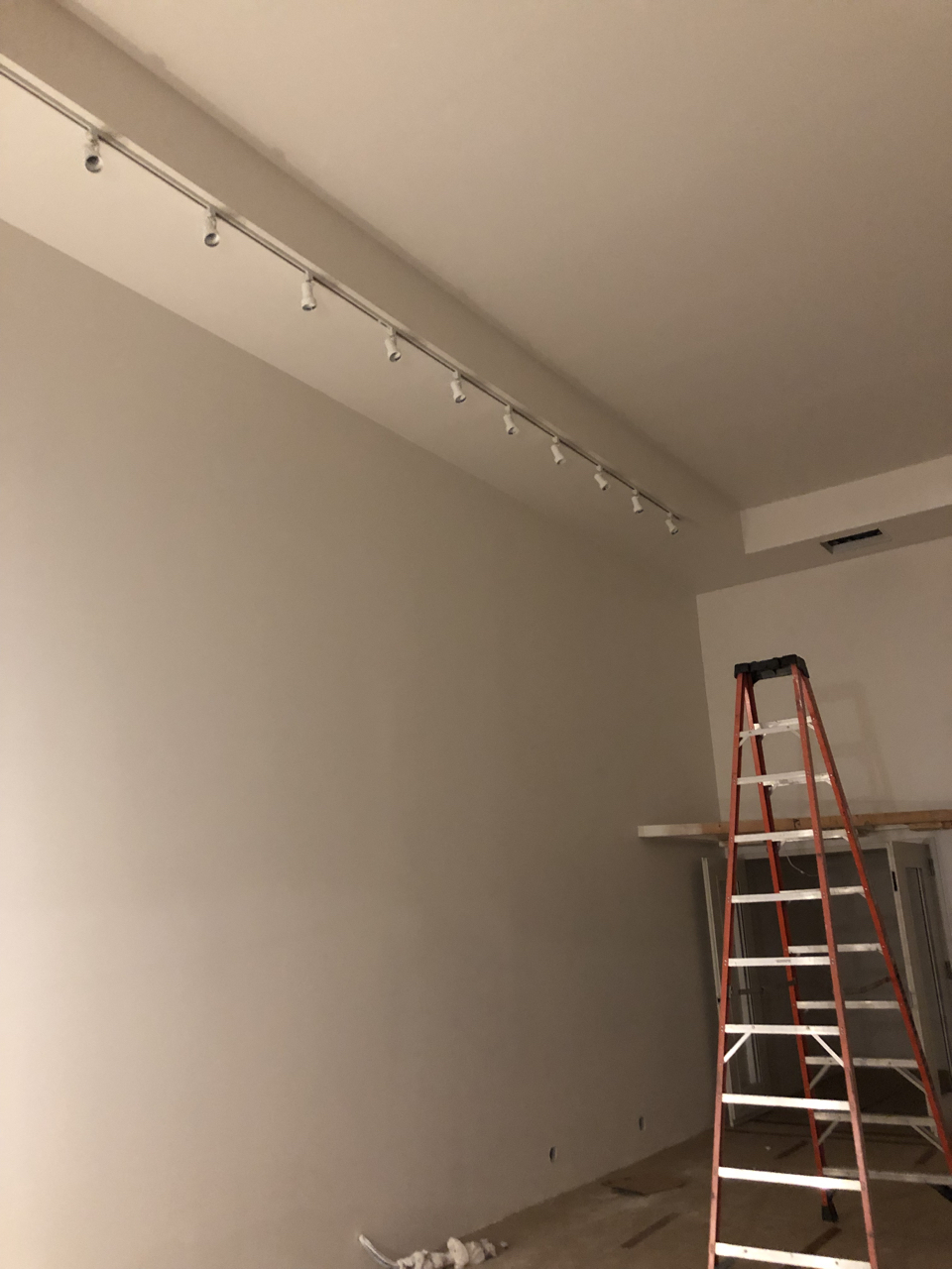 Track lighting hanging in tracking room 1.