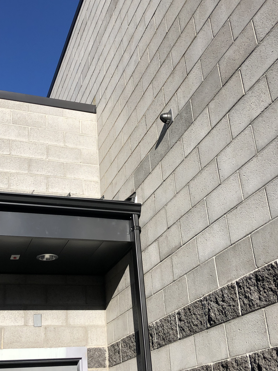 The security company began to install the exterior cameras.