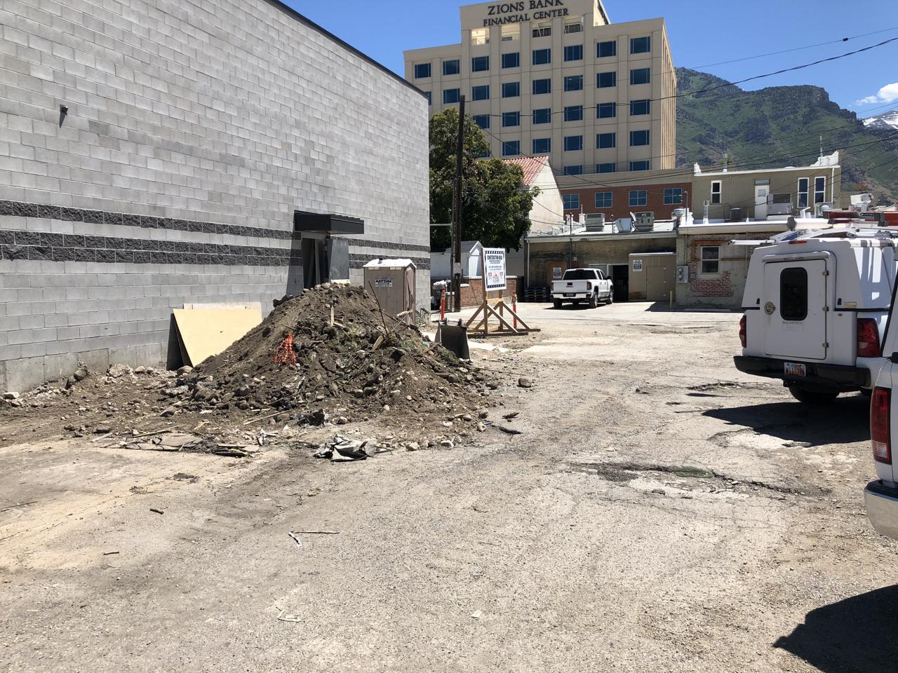 Behind the studio the excavators began preparing the alley for asphalt.