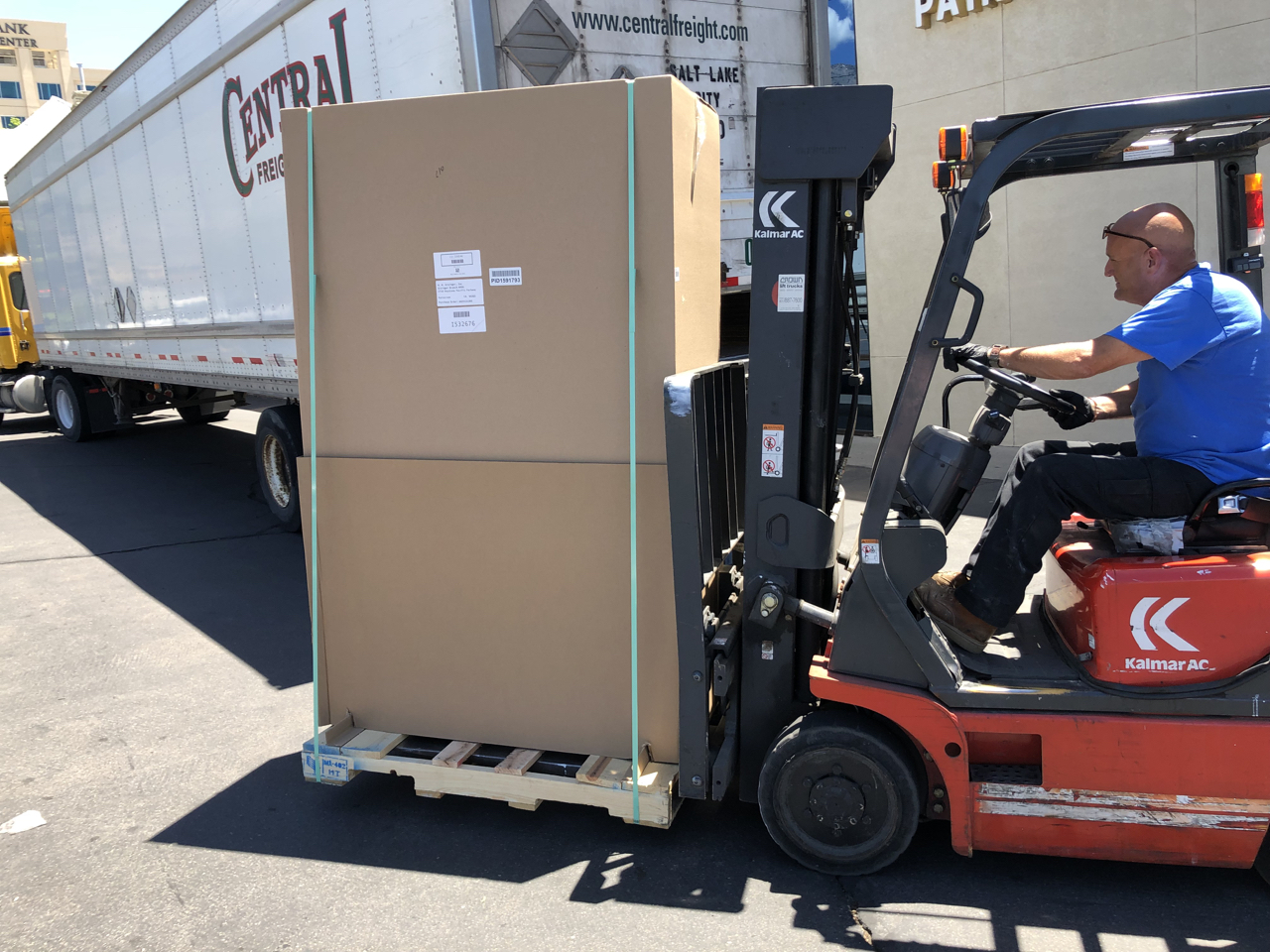 Our    Durham Manufacturing    microphone storage cabinet arrived and lucky for us our neighbors at Jones Paint & Glass were willing to help us out with their forklift.