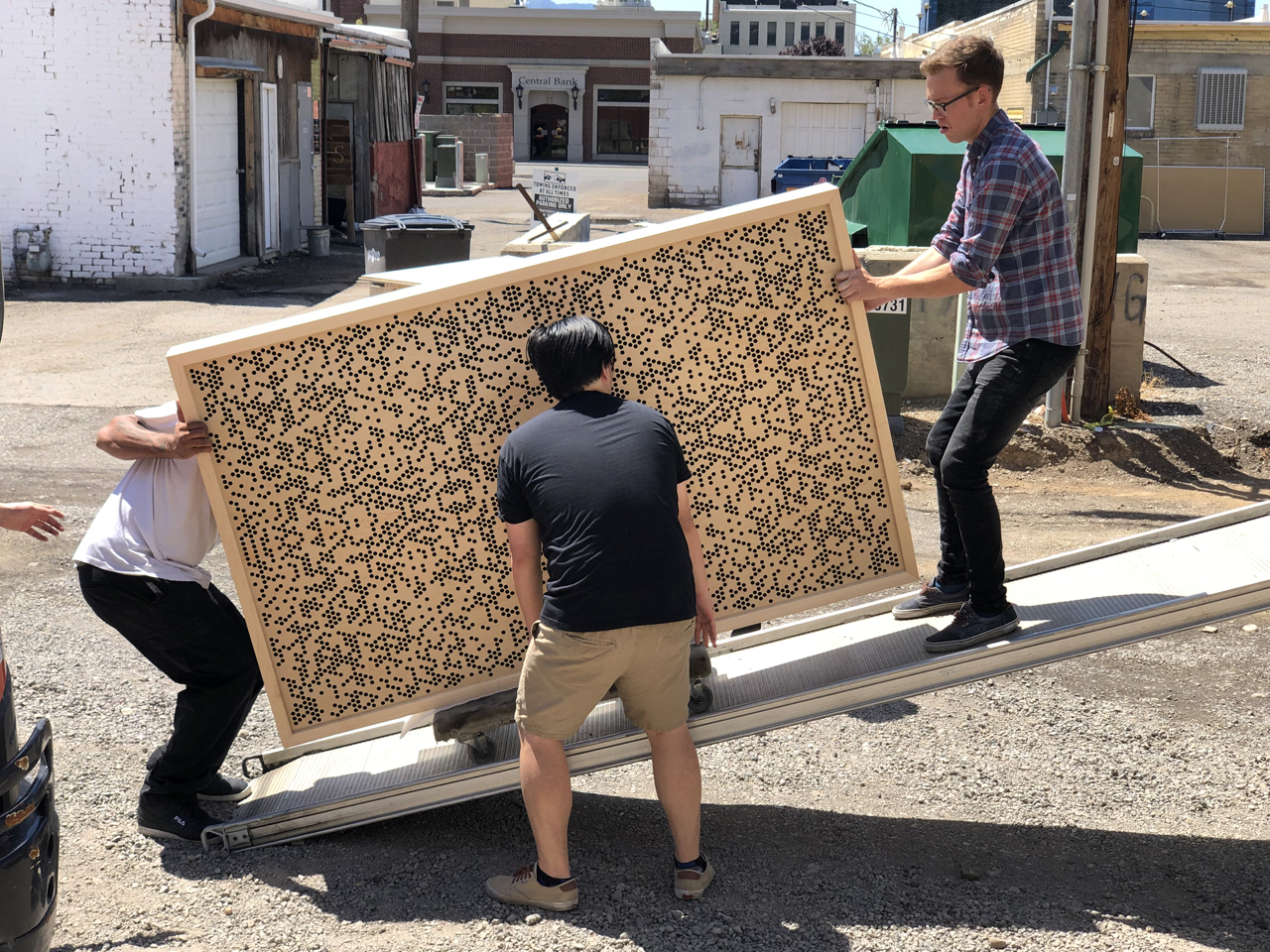7 of us spent about 4 1/2 hours unloading one of the trucks. There are few thing as nerve-racking as unloading a bunch of finely crafted finished wood work and fragile fabric covered insulation panels. Here we are unloading one of the 6 beautiful gobos Tony Brett and his crew built for us.