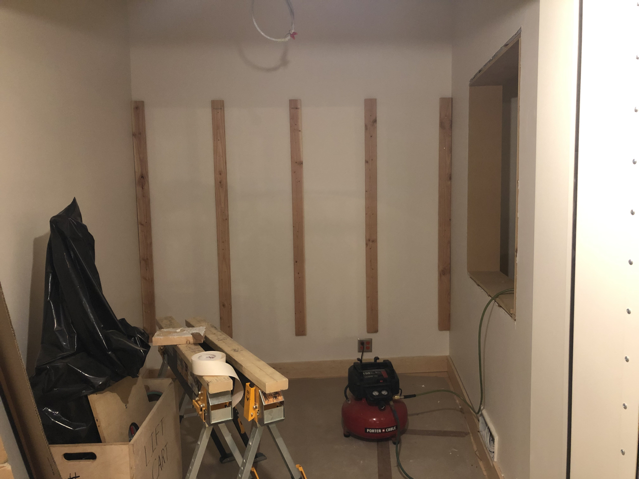 Framing for the wall treatments in studio 1 iso booths.