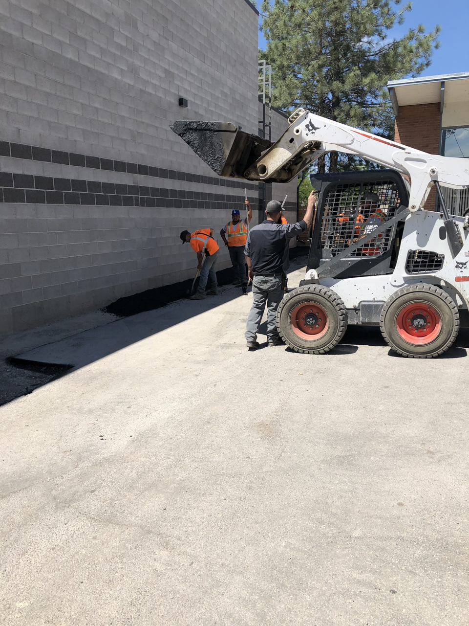 It took a number of weeks but we finally got asphalt. It's great to finally have a rear parking area and to have things cleaned up around the edge of the building, but even more important it means that the HVAC condensers were able to be placed.