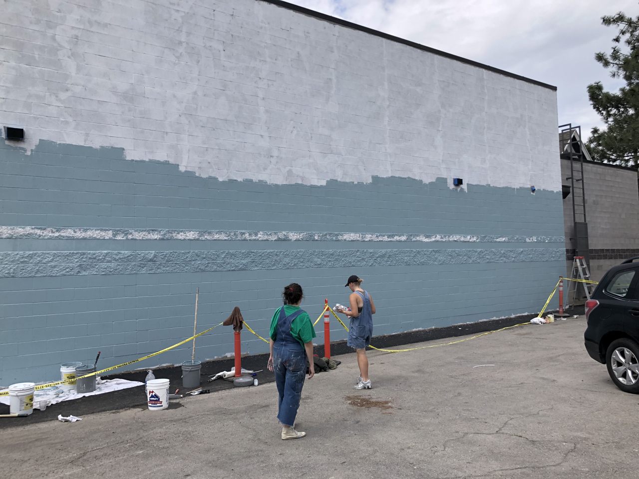 Provo City has a mural program    that helps pay for outdoor murals. Most tend to be fairly small but they really wanted to make something large on our building. The artists are pictured here working on the background.
