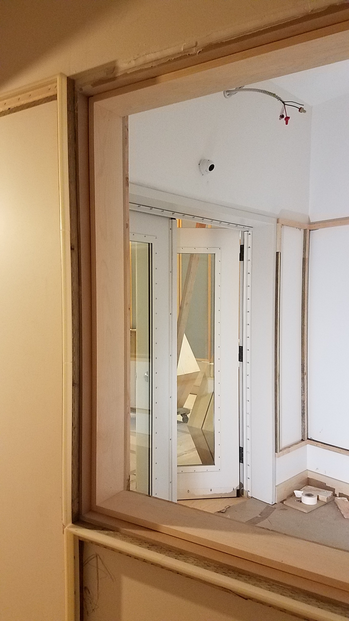 Maple window stops were installed in the openings between the three booths in tracking room 1.