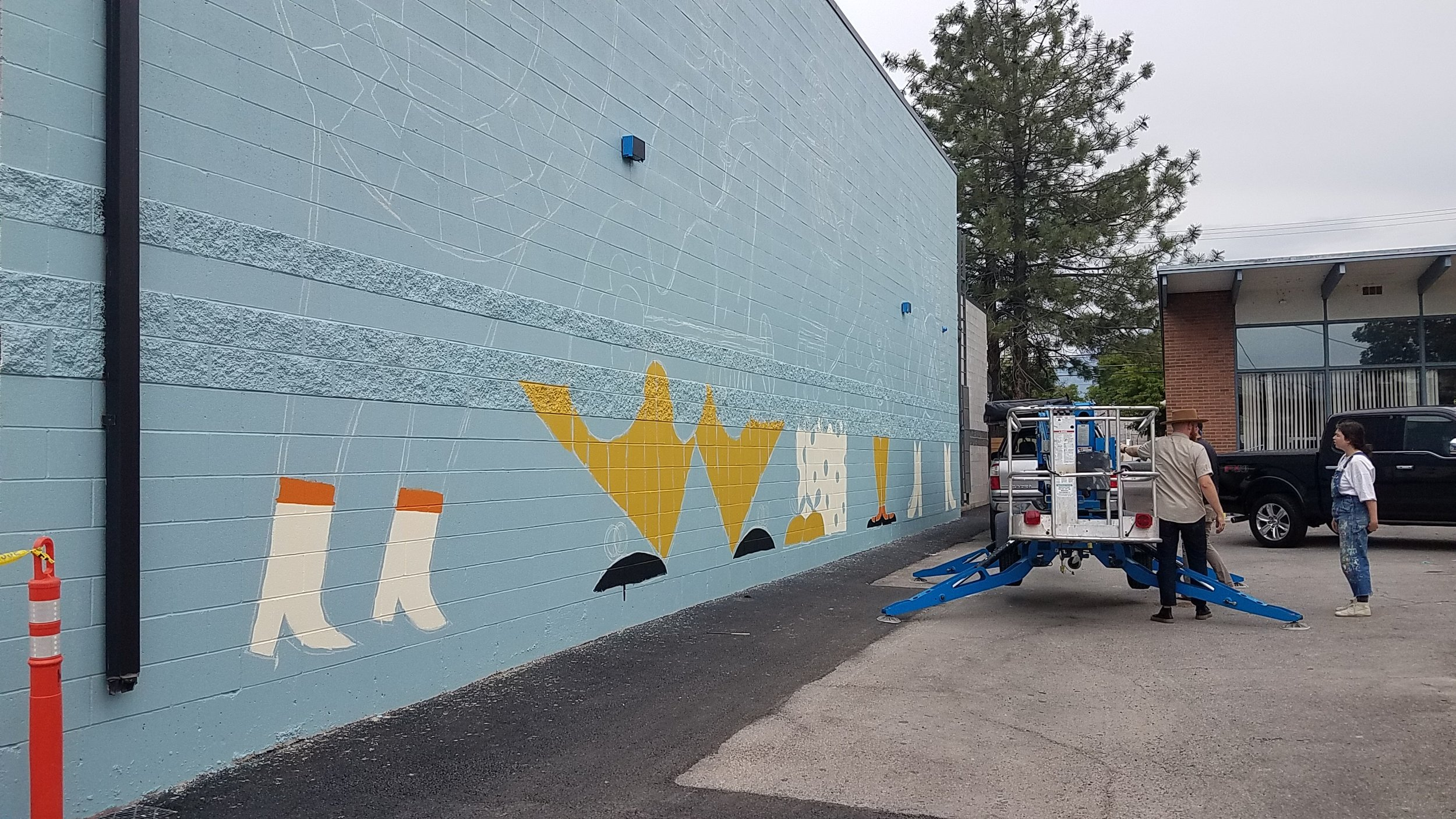 Work on the mural continues.