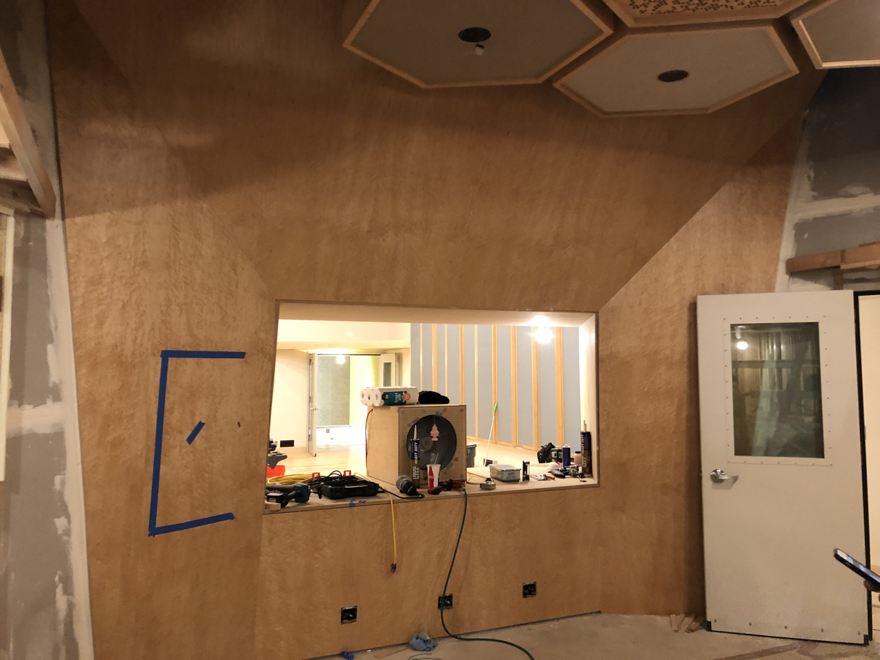 The birdseye maple front wall in control room 1. The speaker soffit boxes are behind the maple ready to be routed out.