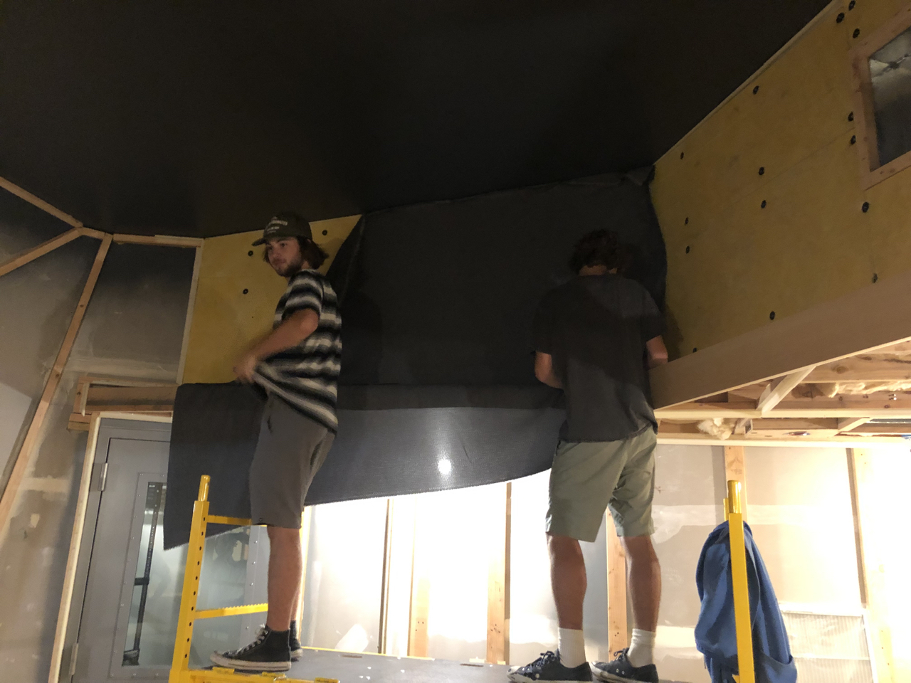Fabric going up on the control room 2 soffit returns.