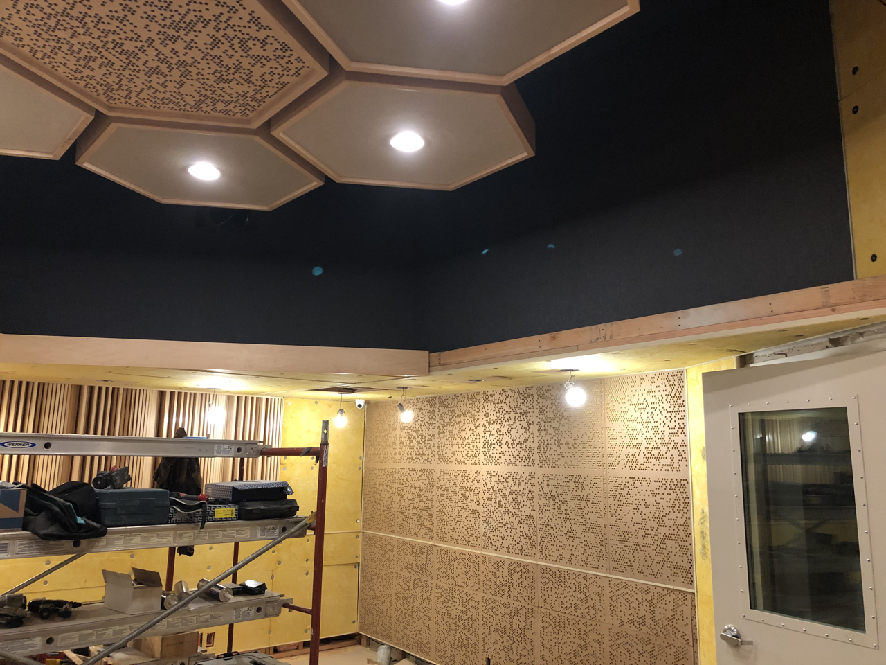Soffit returns in control room 1 with fabric installed.