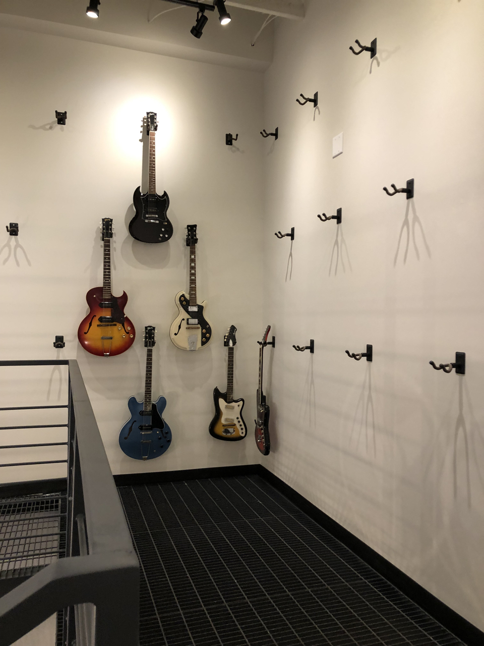 Moving the guitars from the house to the new instrument room was a big job full of multiple trips up and down the narrow old staircase of the house and the new metal staircase in the storage room.