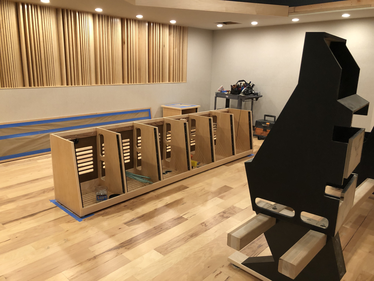A few days before Brett Acoustics left the site they started setting the credenzas and building the desks for the consoles.