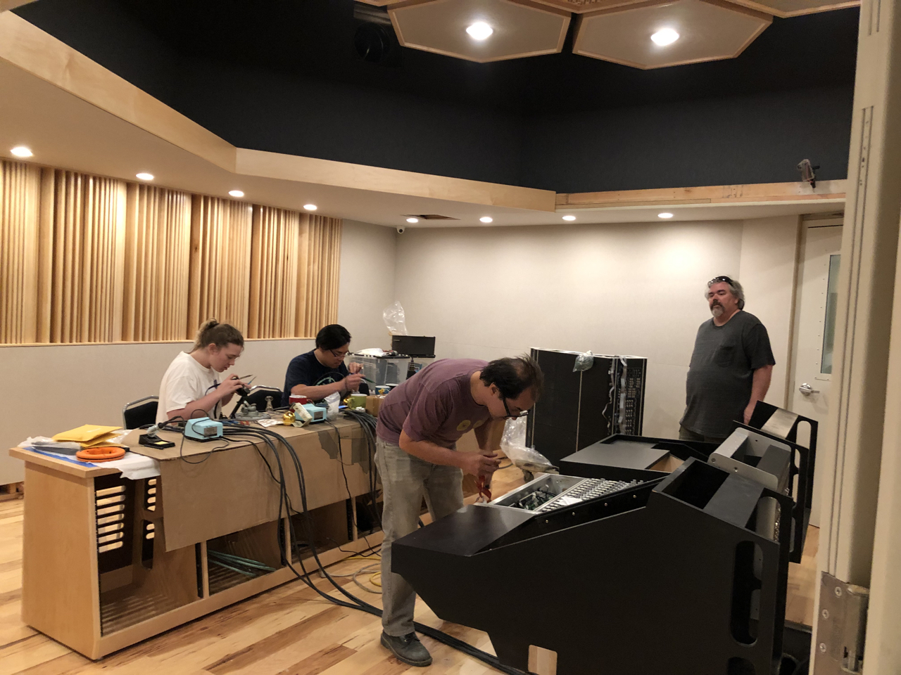 Maren, Ryan King, Thom Canova and Tony Brett working in control room 1.