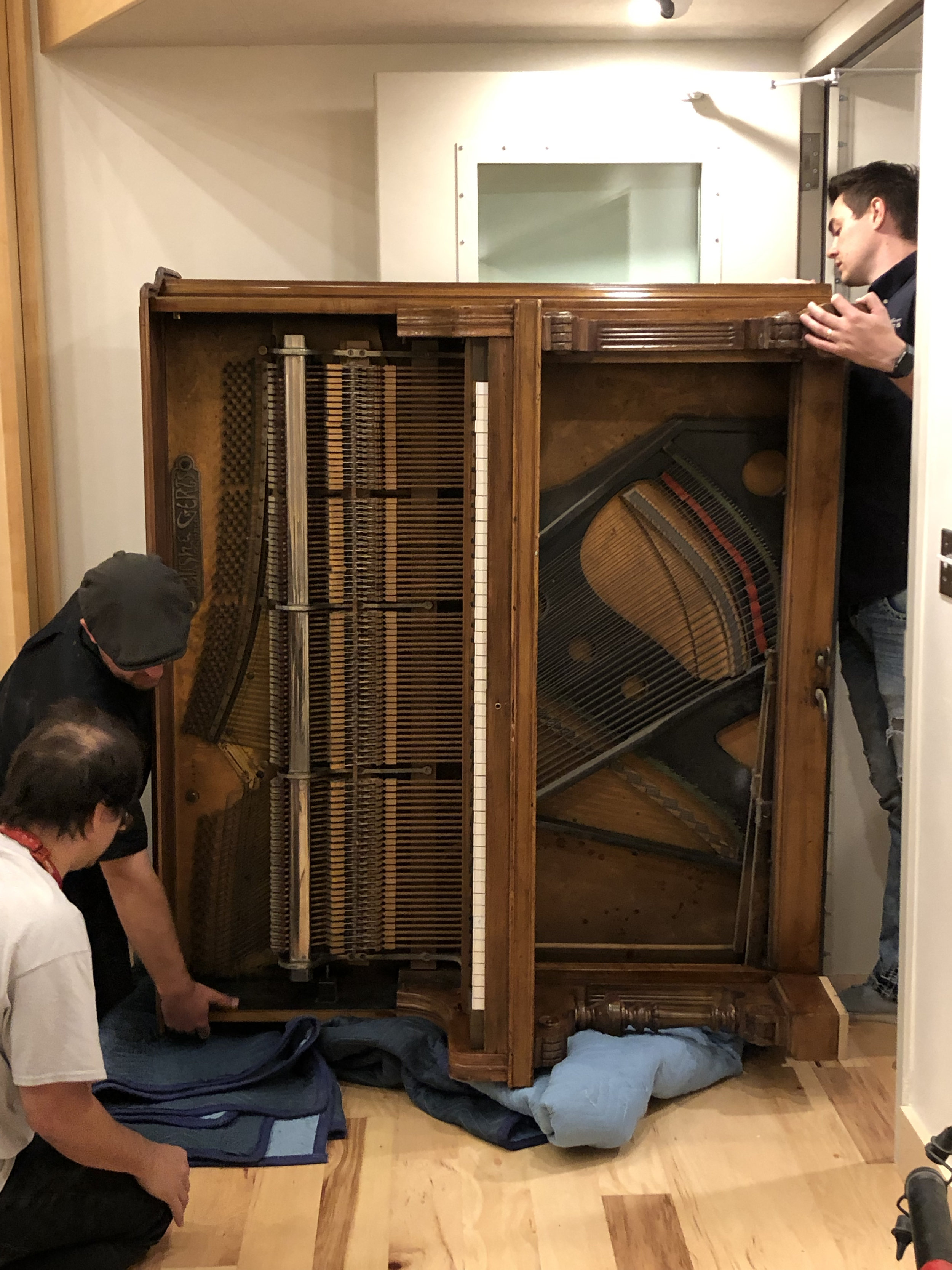 2 days before our first session in Studio 1, piano movers brought our old Bush and Gerts upright from storage and moved our Yamaha C7 from the house into the new space. The upright was the biggest challenge as it is incredibly heavy and wouldn't go through the doors and around the corners right side up.