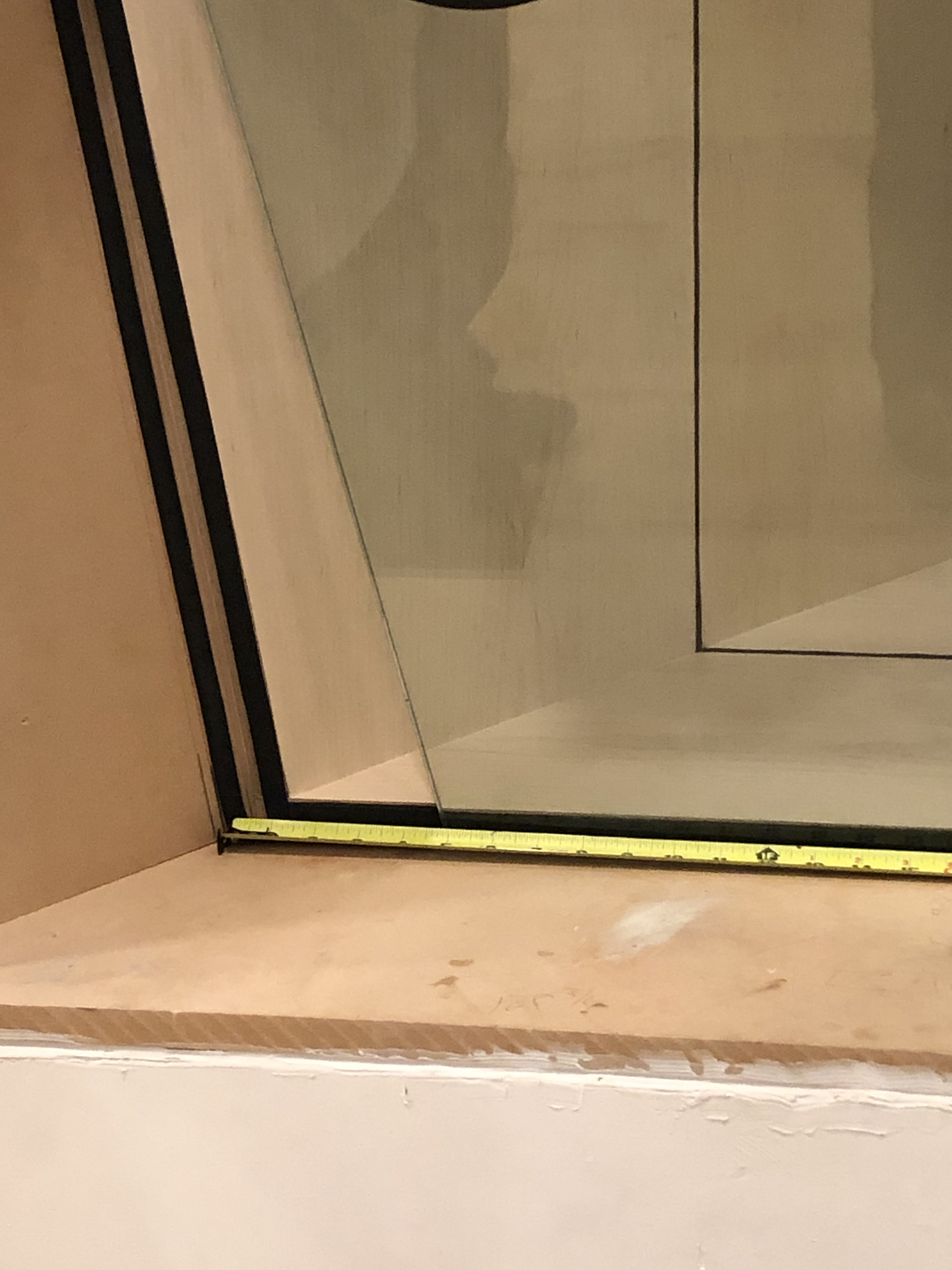 """…and then we heard the installer on one end say """"you need to come my way a lot"""" and then the installer on the other side said """"no, it needs to come my way a lot."""" As you can see, somewhere along the way one of the measurements was wrong and the glass was cut incorrectly. It fit great on top but was ten inches short on the bottom. So our first session in the studios didn't have total isolation, or a trimmed out window, but it was a lot easier to leave that huge piece of glass in that spot than take it out and find somewhere to put it while we waited for a replacement."""