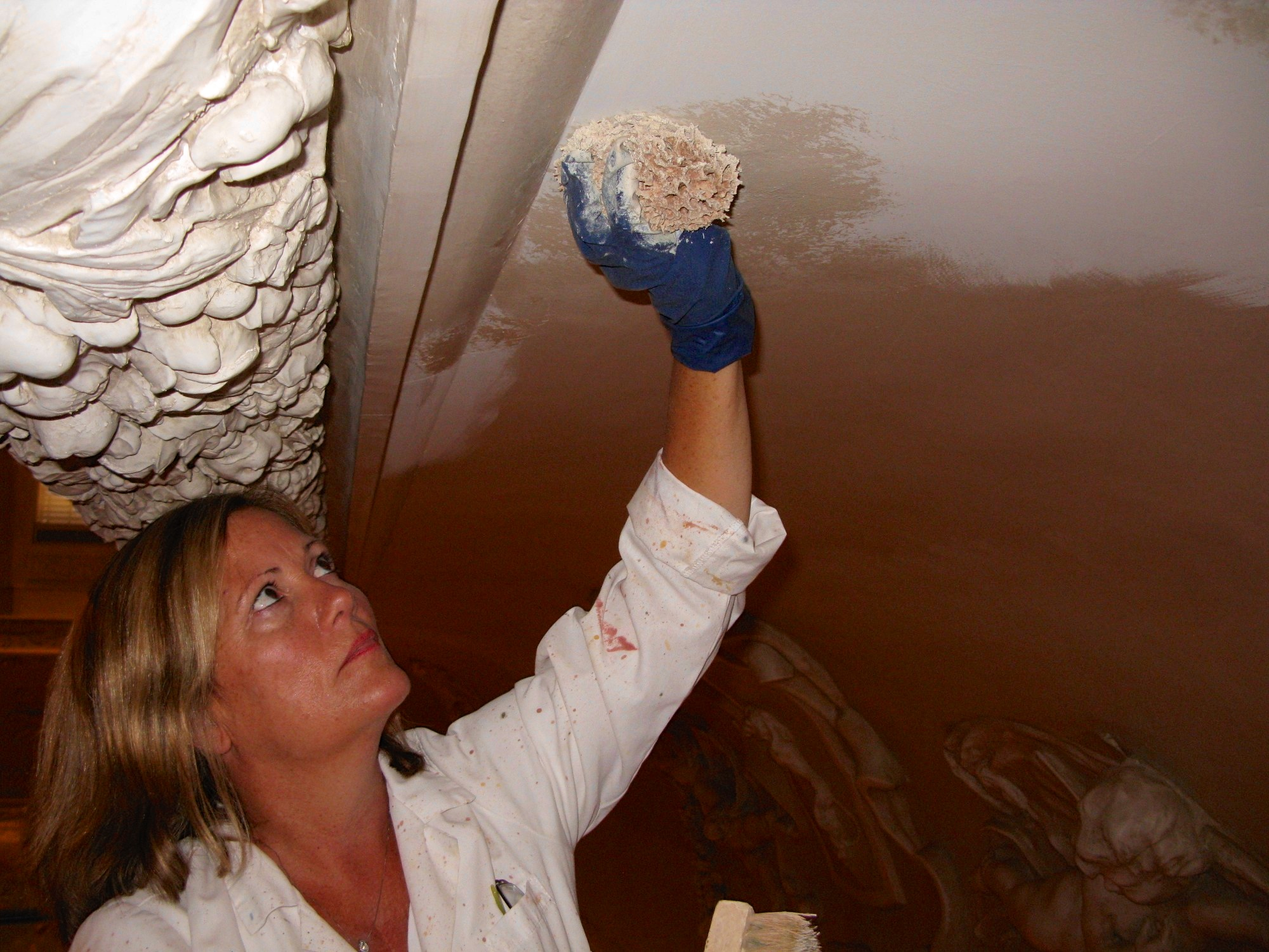 Alene Pettus restoring the cornice of The Rubens Gallery at the Ringling.