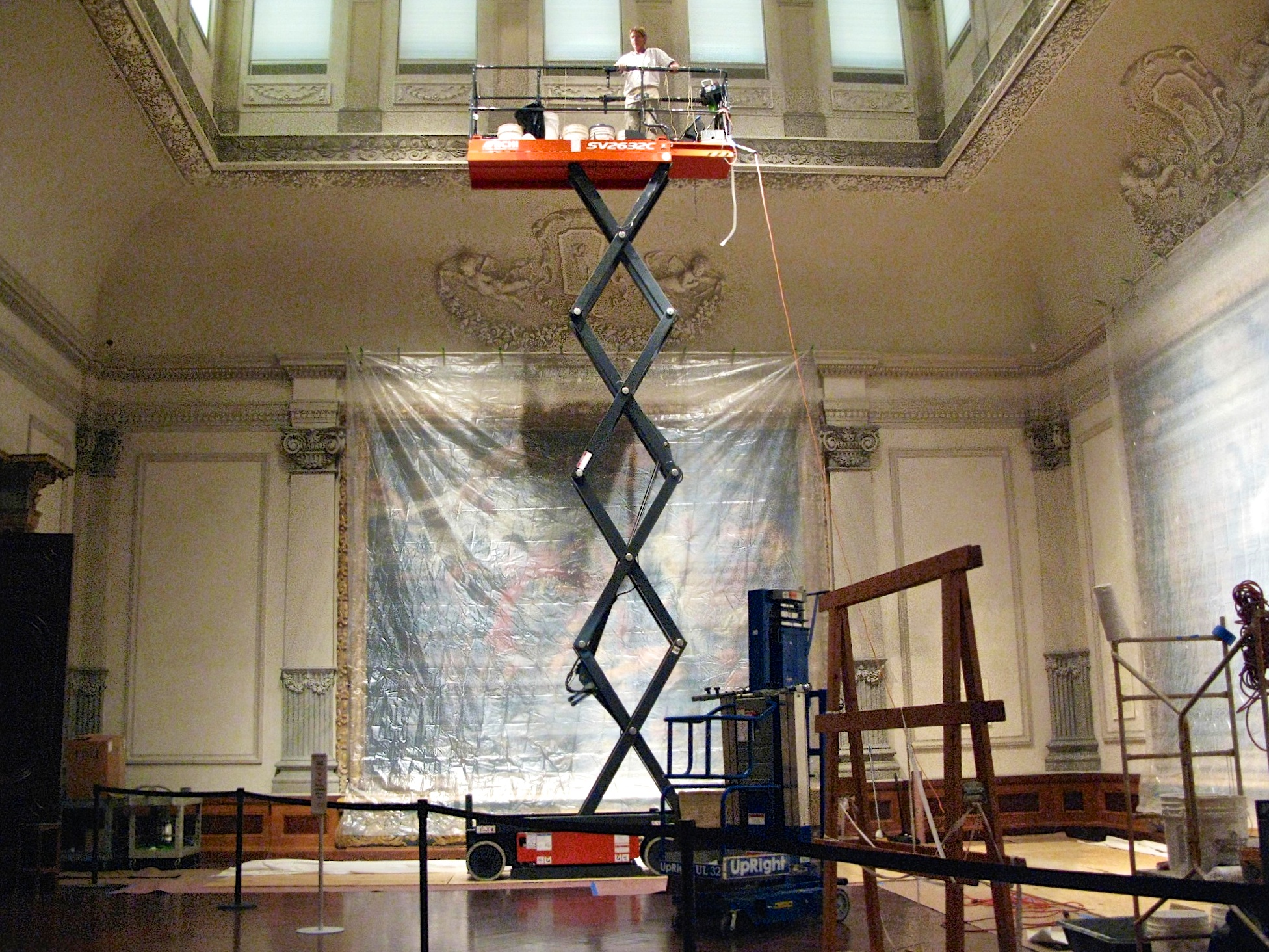 Jonathan Pettus restoring the decorative plaster surface structures of the Rubens Gallery at the Ringling Museum of Art.