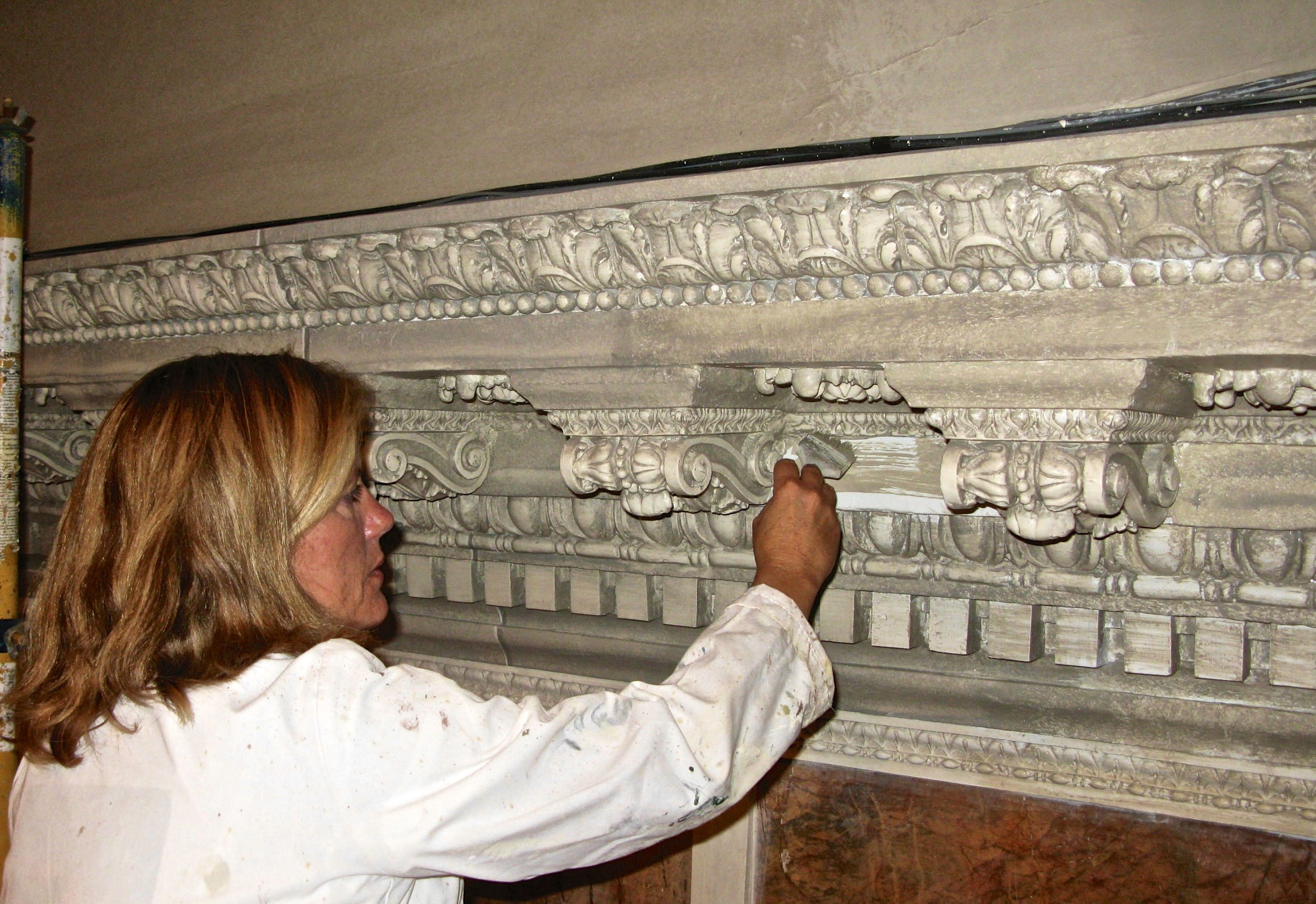 Alene Pettus restoring faux marble at the Ringling Museum of Art.