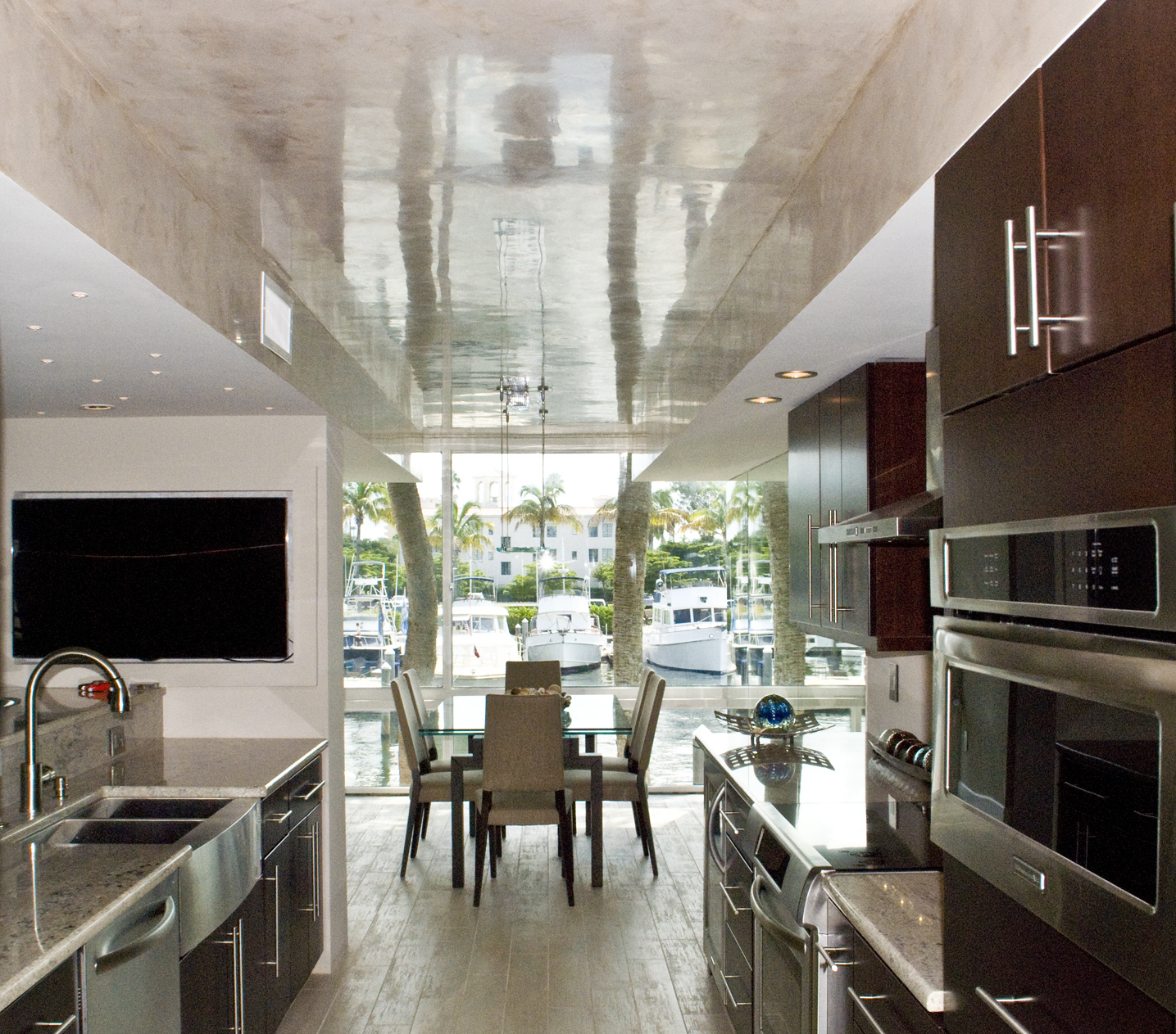 A-slick-Venetian-Plaster-ceiling-reflects-the-water-for-this-marina-suite-with-a-renovated-kitchen-and-dining-room.jpg