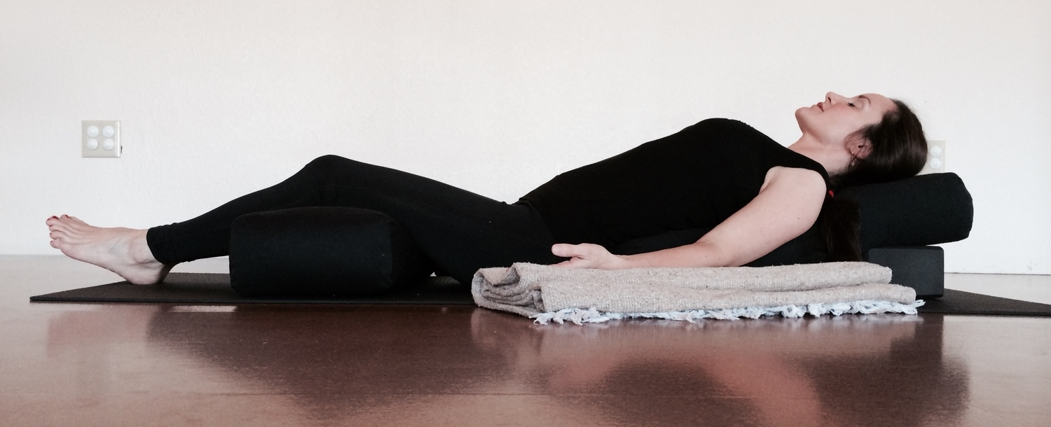 Supported reclined relaxation, a good substitute for savasana during pregnancy, or for students who have difficulty breathing lying down (fairly common for those with heart disease, high blood pressure, or respiratory disorder).