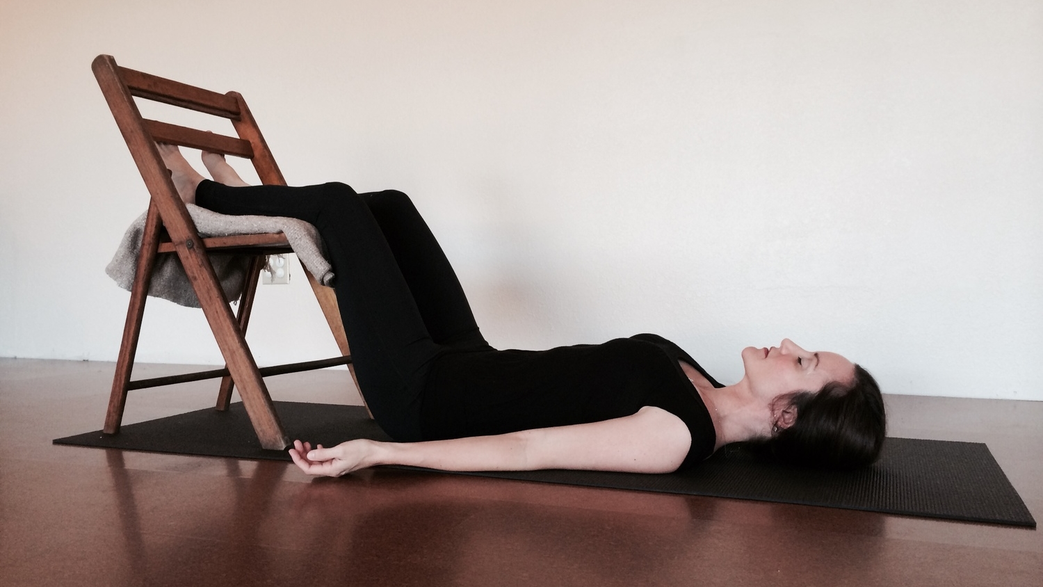 Legs-up-the-chair, a modification of savasana that is especially relaxing to the back and hips.