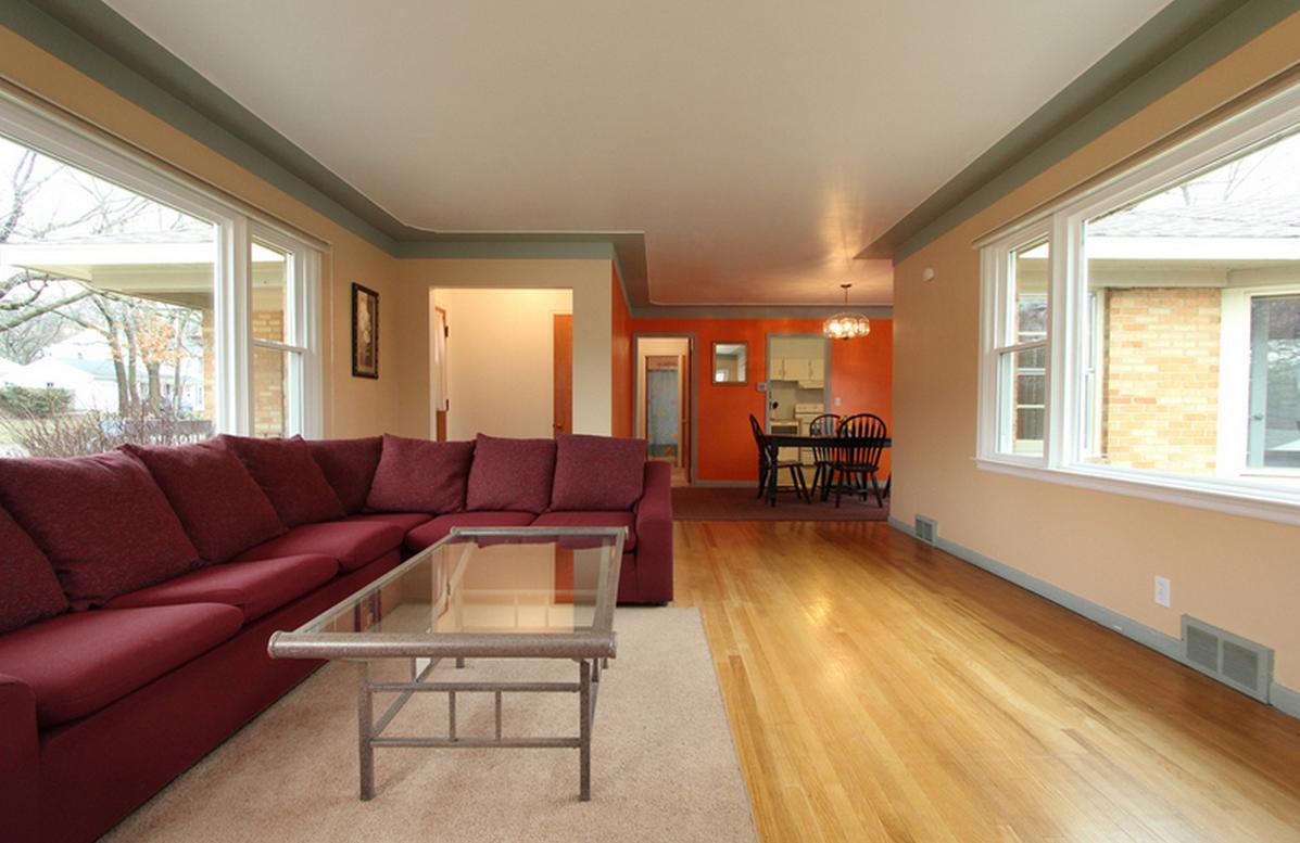 Living Room looking towards Dining/Kitchen/Hallway (Bedrooms + Bath)
