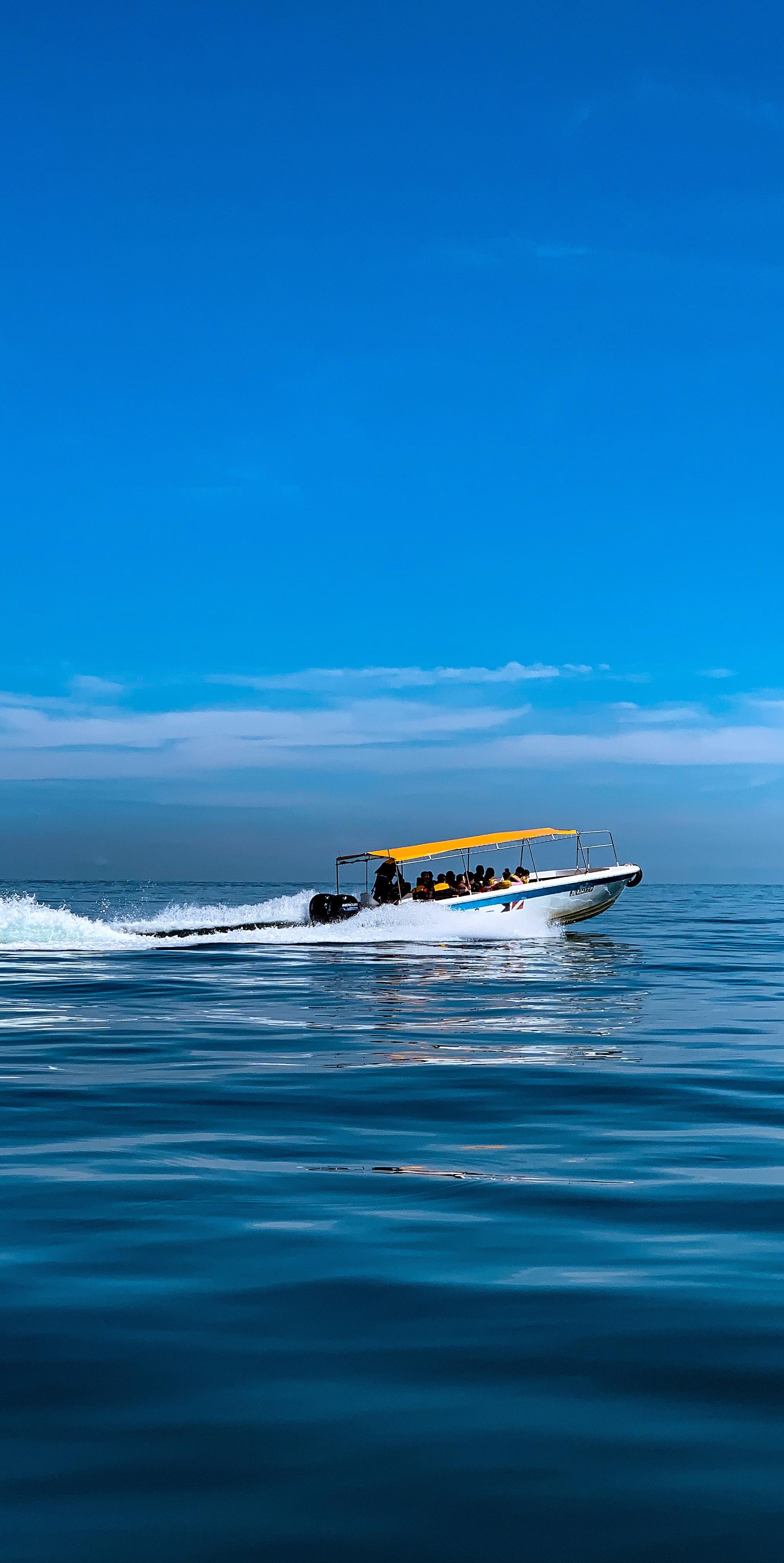 Boats glide across Gaya Bay.