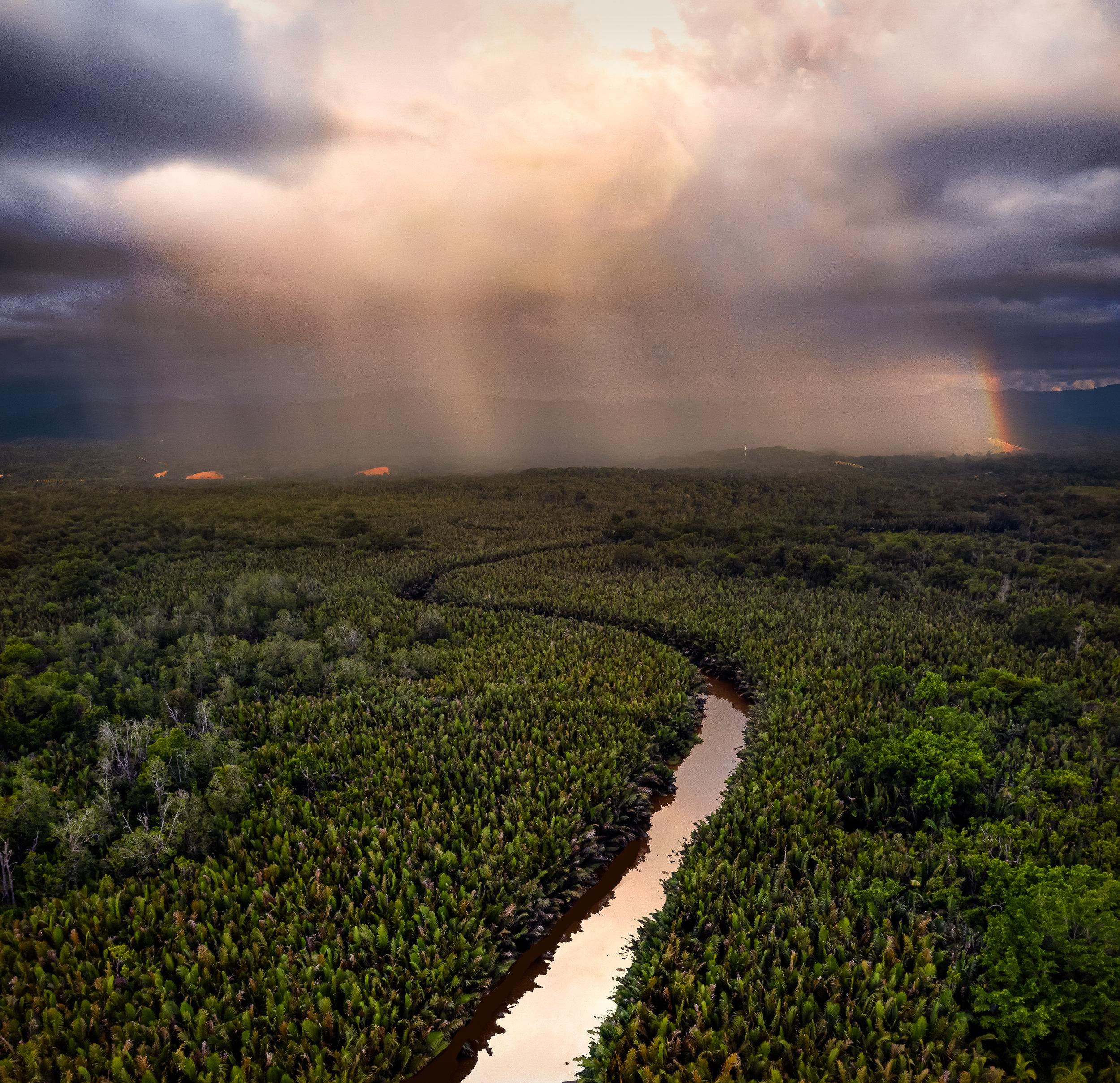 Rainbows, rainclouds, wetlands, rivers. Shot on the DJI Mavic 2 Pro, by Joshua Karthik.
