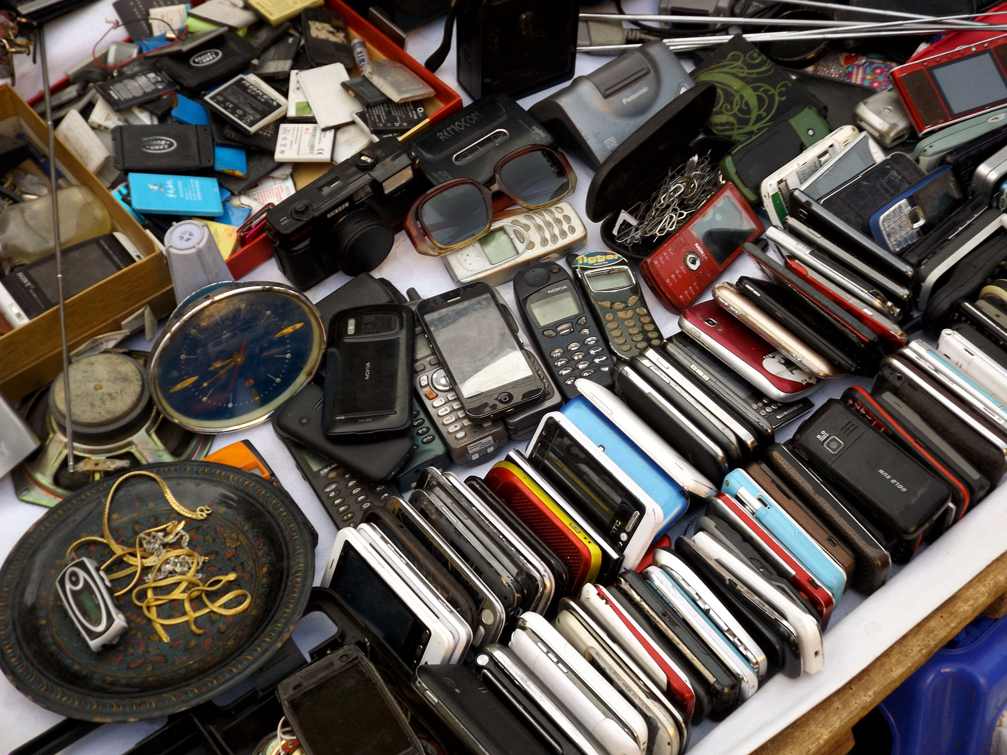 Phones for sale at a black market stand