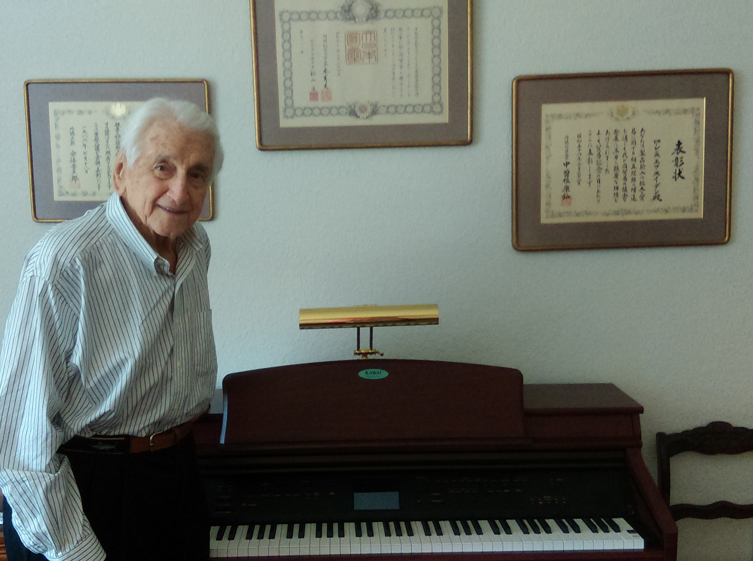 Lt. Gen. Snowden poses with his personal piano, given to CCS.