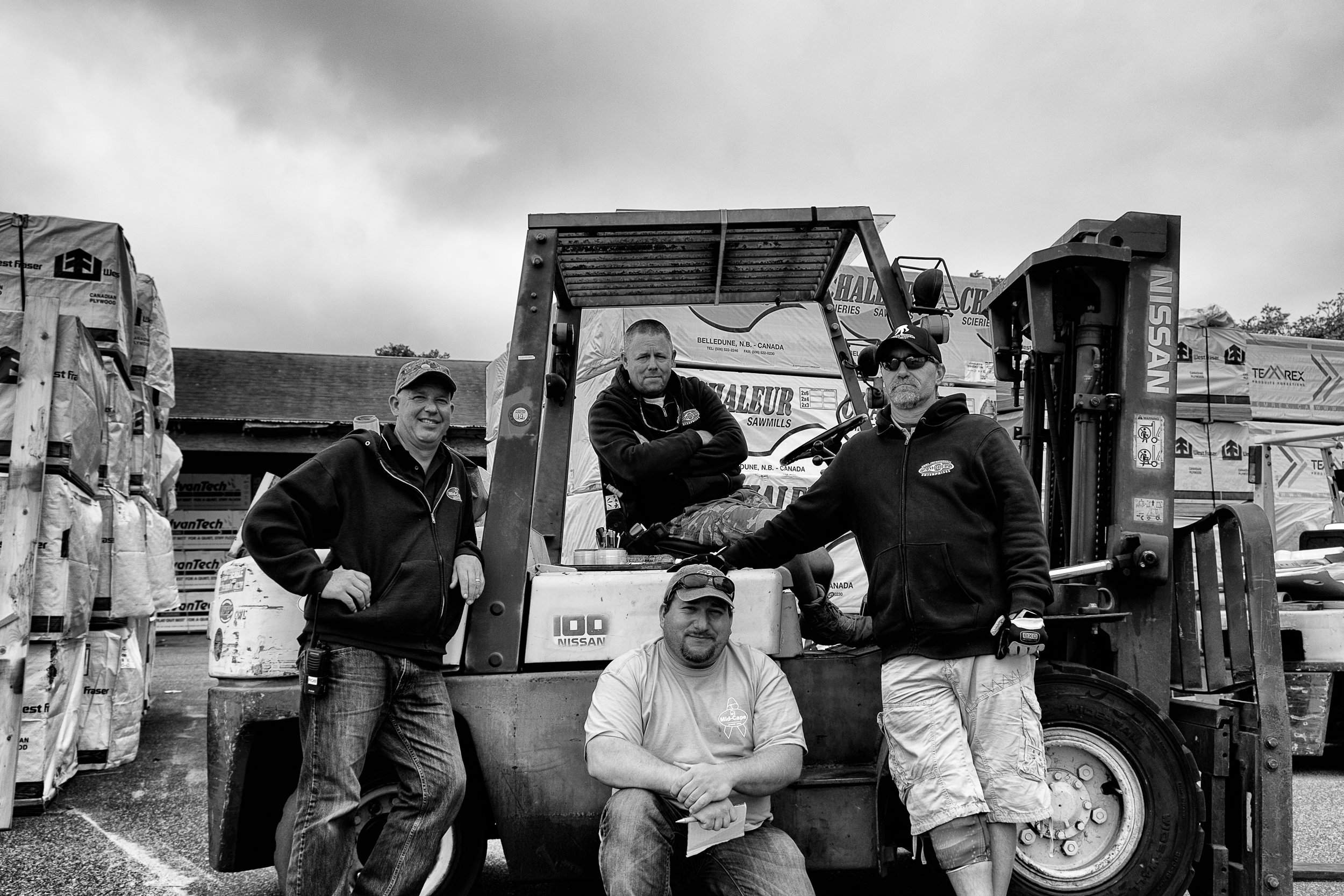 Rob, Chris, Andy and Jeff posing for a photo out in framing during a gray day in September