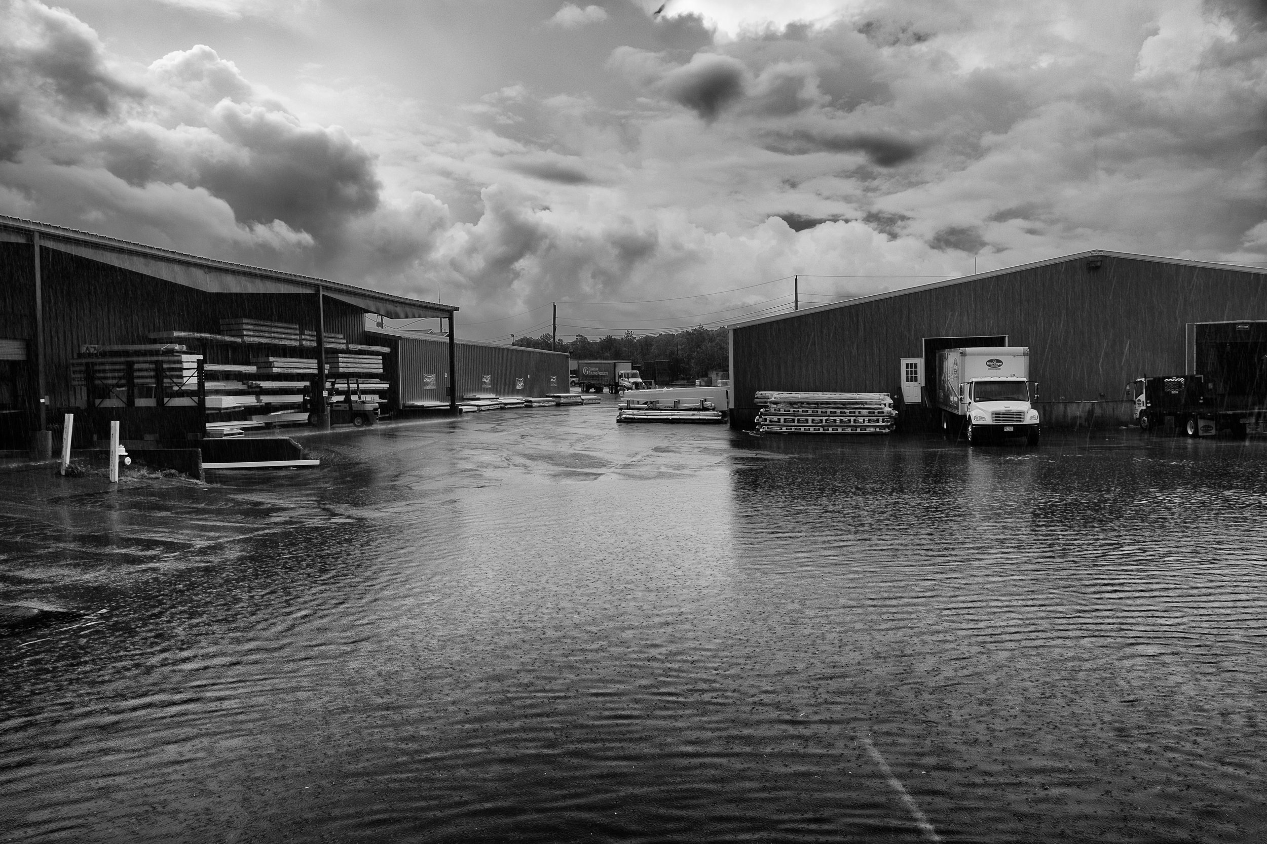 During heavy rains, the parking lot in between Building 9 and Building 4 floods to nearly knee high water at some points. Despite this, the yard keeps humming away.