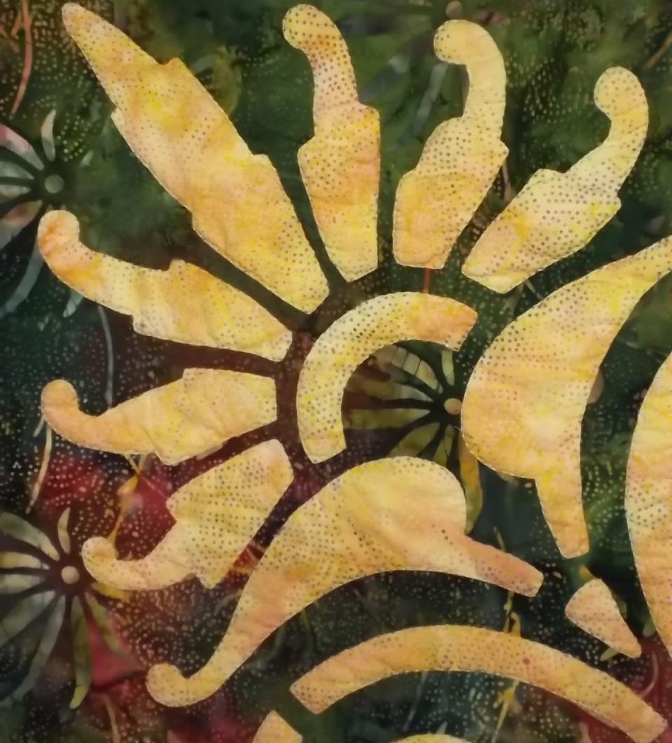 Scroll & Fan, Medallion III. Reverse applique revealing the yellow background fabric.