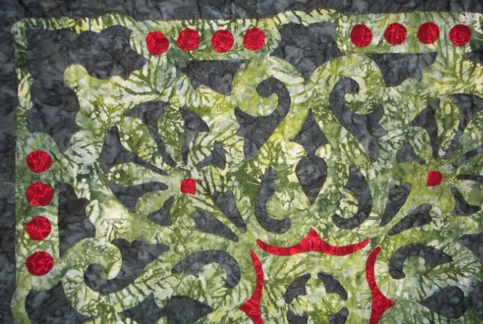 Christmas Berries     ,MedallionVII.    Green top created with reverse applique, red appliqued on.