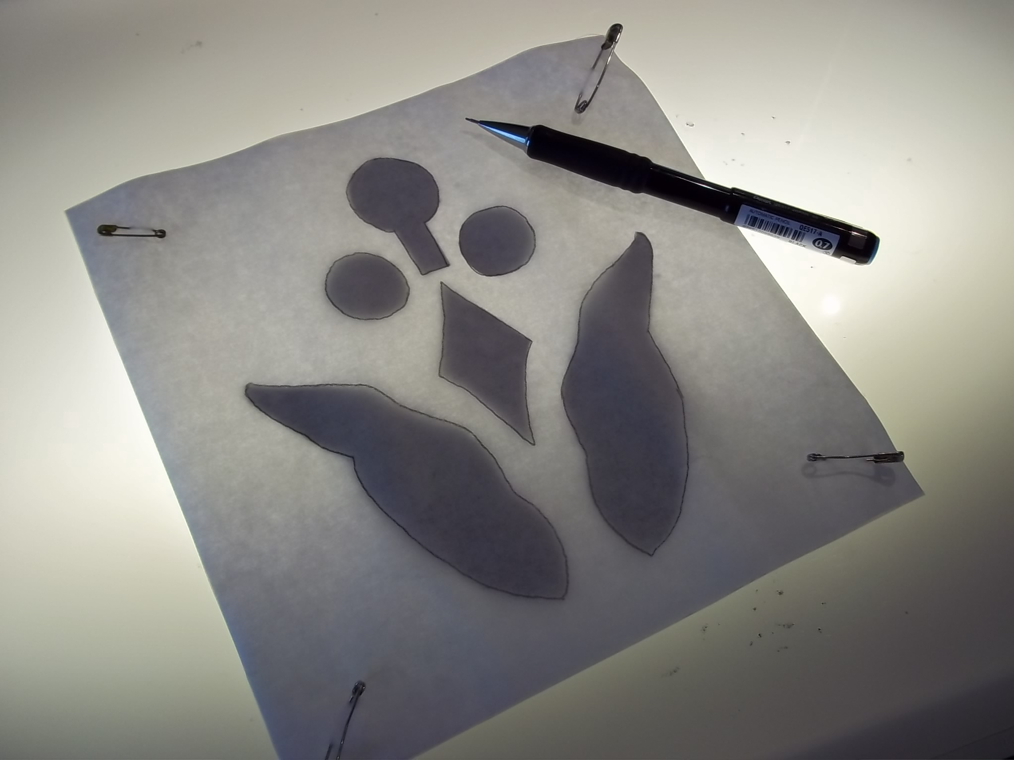 1. Trace pattern onto paper side of fusible webbing