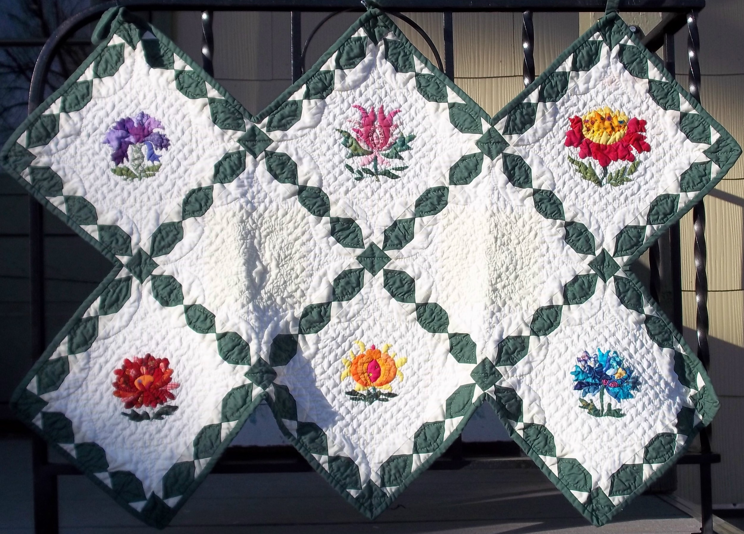 Summer Flowers. Hand applique, machine pieced, hand quilted.