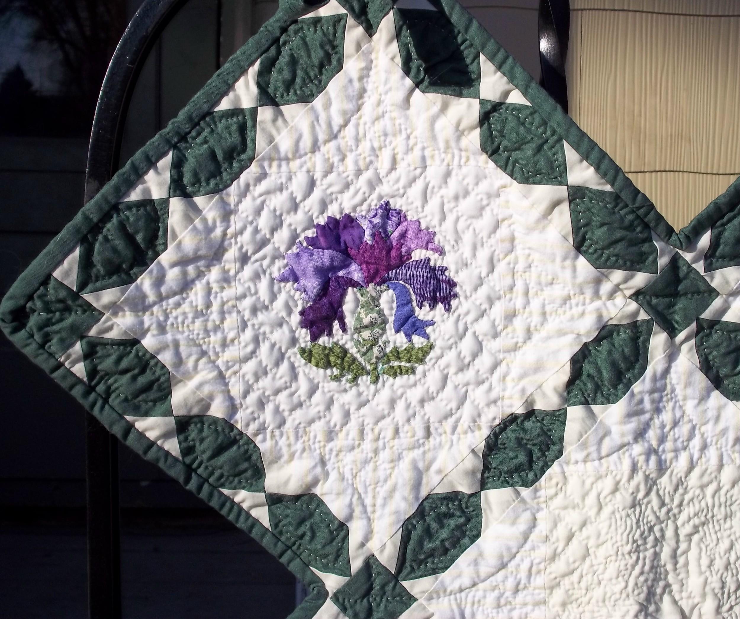 Purple flower, upper left corner.