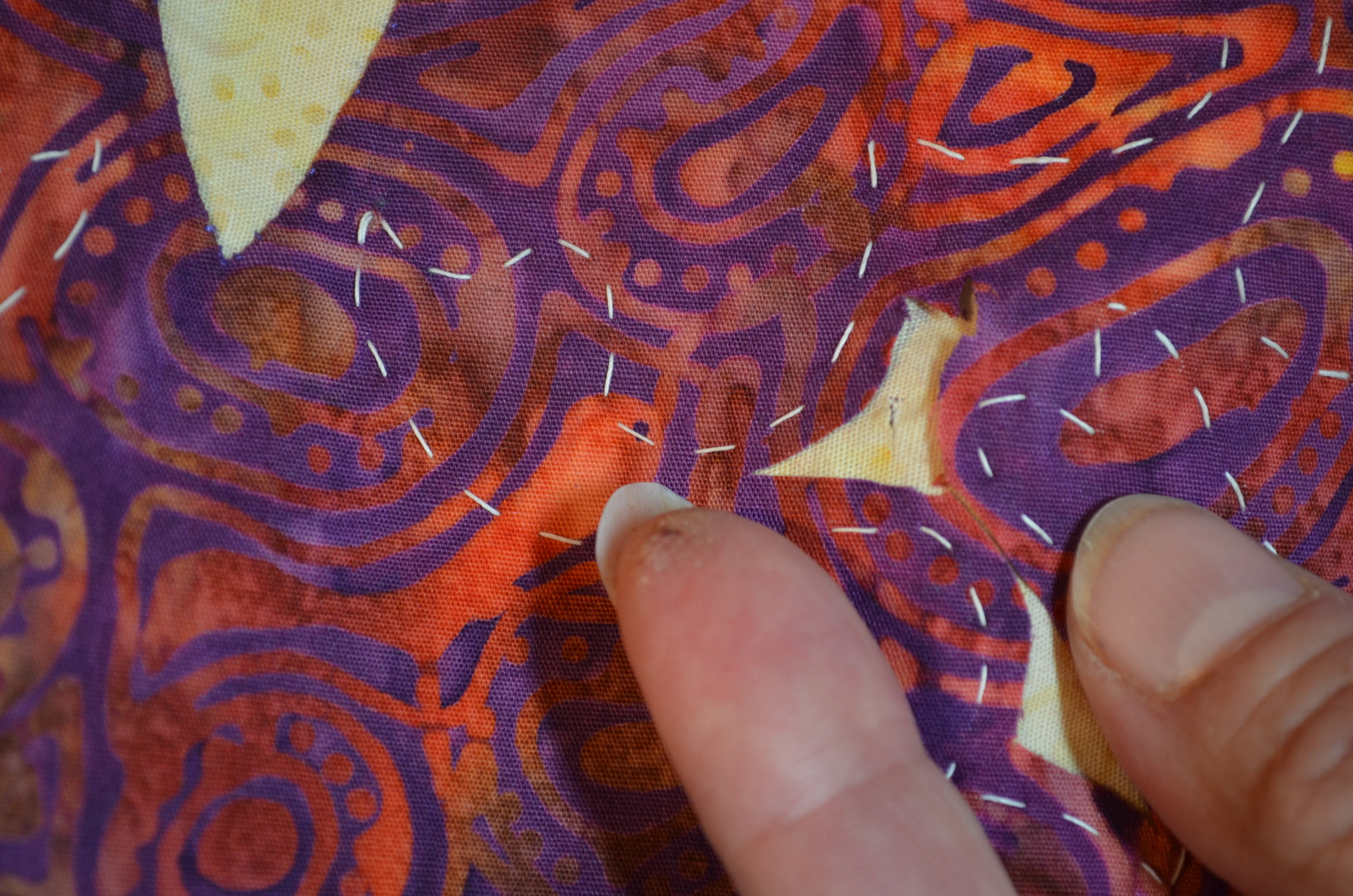 OOPS! I snipped my background fabric when trimming the top.