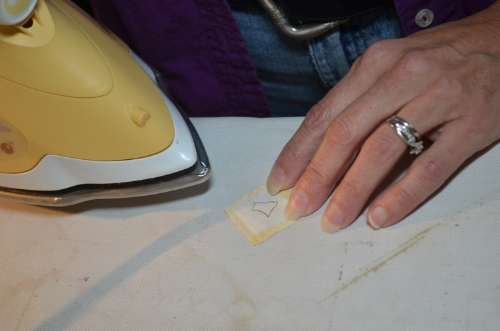 6. Iron fusible onto right side of background fabric.