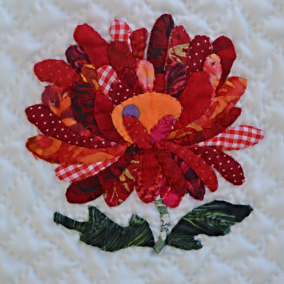 Appliqued flower with trace, baste, snip & stitch!